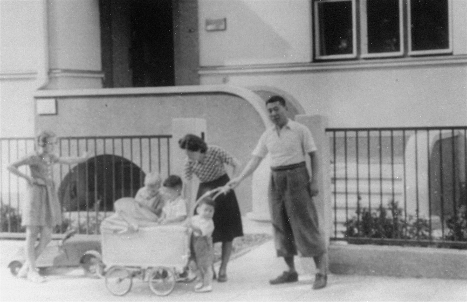 The Sugihara family in front of the Japanese consulate in Kaunas.    In the baby carriage is the Sugihara's third son Haruki, who was born in Kaunas and died of leukemia in 1947.