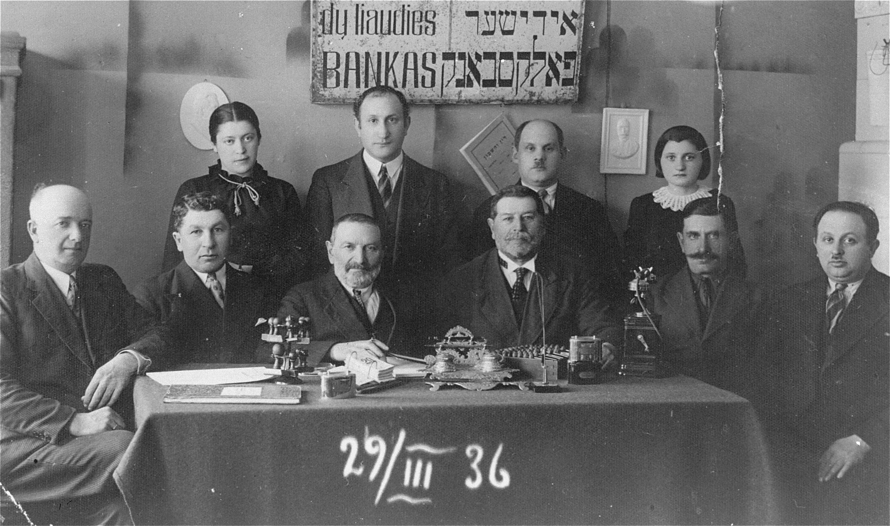 Group portrait of members of the board of the Jewish bank in Gargzdai, Lithuania.