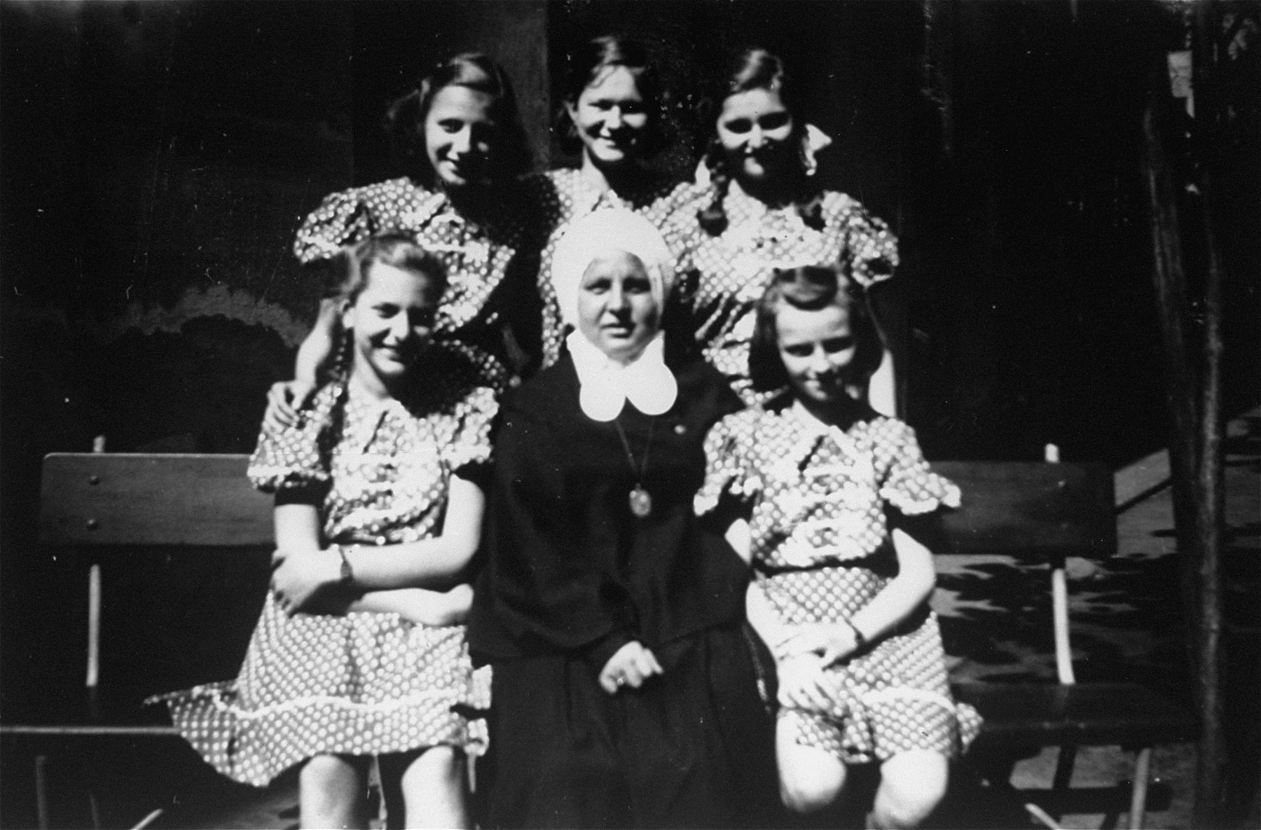 Dorottya Dezsoefi (second row, right) and her twin sister Ida Marianne (first row, left) pose with a nun and other students outside of the convent school where they were hidden for two years.