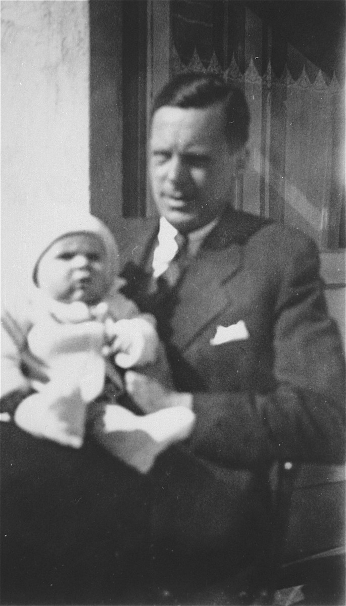 Honorary Dutch Consul Jan Zwartendijk with his son Robert in Kovno.  Jan Zwartendijk (1896-1976) arrived in Kovno in 1938 as the Dutch representative of Philips Electric in Lithuania.  Soon after the fall of Holland to Hitler's forces on 10 May 1940, however, Zwartendijk was named the honorary Dutch consul by ambassador LPJ de Decker in Riga, Latvia, who sacked the official consul for having pro-Nazi sentiments.  This change came at roughly the same time as the Soviet occupation of Lithuania in June 1940.  Zwartendijk was then approached in the third week of July 1940 by Nathan Gutwirth, a Dutch national and young yeshiva student in Tels, Lithuania, who he had come to know through their common interest in soccer. Gutwirth requested a transit visa to Curacao, which Zwartendijk was denied permission to give.  Zwartendijk then appealed to de Decker for help and the ambassador sent him a document stating that no visa was necessary for travel to Curacao, and that landing was permitted solely at the discretion of the island's governor.  De Decker suggested that Zwartendijk simply strike out the part about the governor's authority and write into Gutwirth's passport an official statement that he was travelling to Curacao.  Zwartendijk followed this course and within hours Gutwirth had spread word about the 'pseudo visas' among the thousands of Polish-Jewish refugees in Kovno, who subsequently flooded Zwartendijk's office seeking 'Curacao visas'.  These 'visas' were then used by refugees to procure Japanese transit visas from Sugihara through the USSR.  It is estimated that by the time the Dutch consulate was closed at the beginning of August 1940, Zwartendijk had written between 1200 and 1400 life saving 'visas'.
