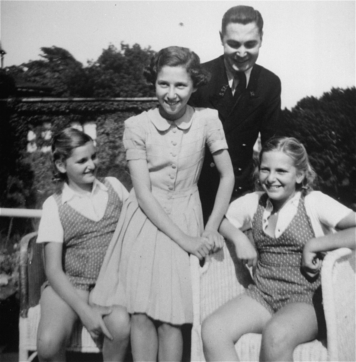 Dorottya (Dolly) Dezsoefi, far left, and her twin sister, Ida Marianne (Mari), with Mr. Zimmermann and his daughter at a resort hotel.    The Zimmermanns did not survive the war.