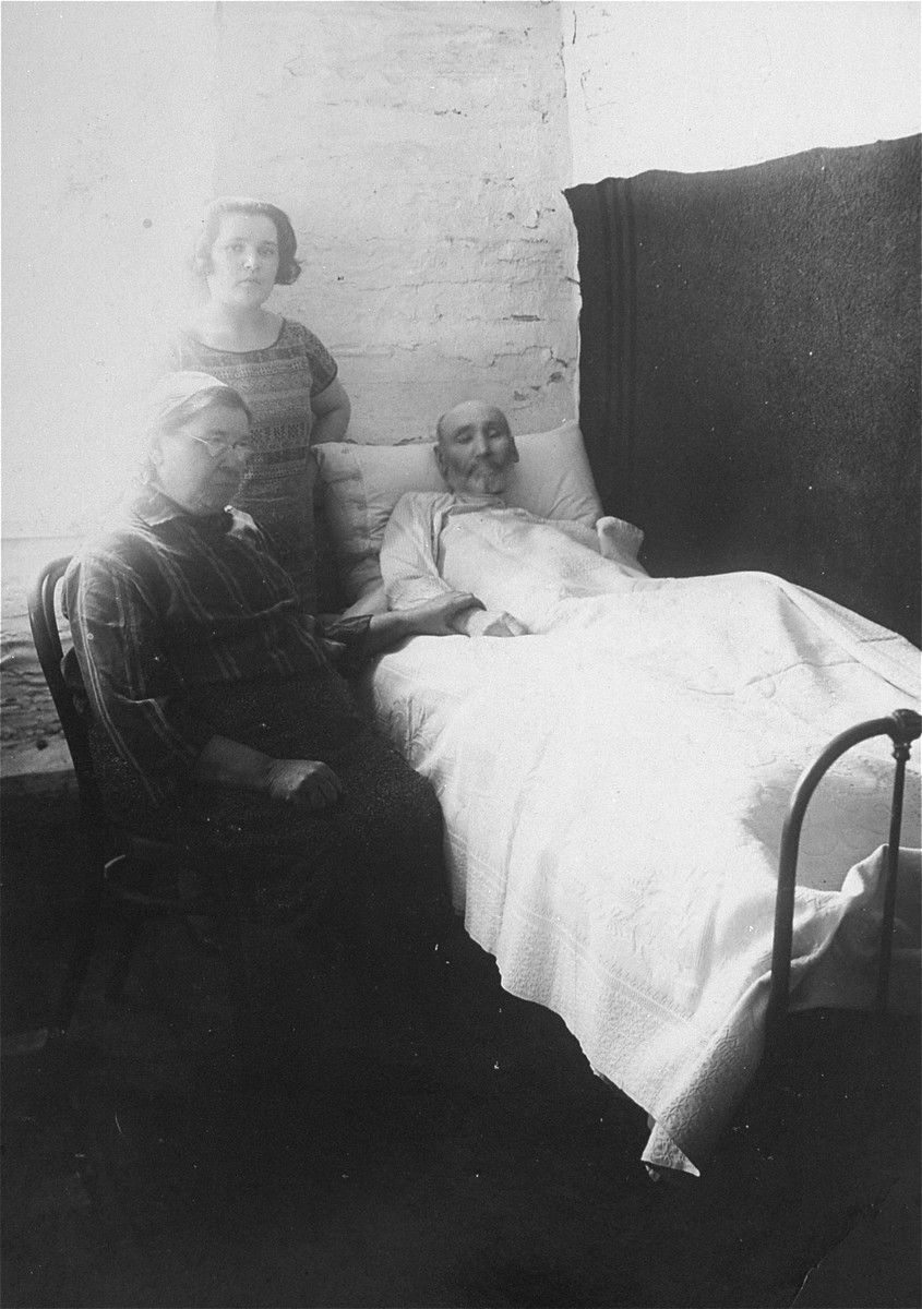 Portrait of the donor's mother, Chaya Gar, visiting her sick father in the hospital, along with her mother.