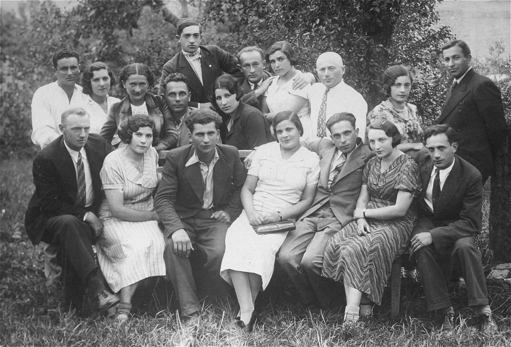 Group portrait of young Jewish men and women in Lithuania.  Pictured in the back row, center, is the donor's father, Eliezer Kaplan.