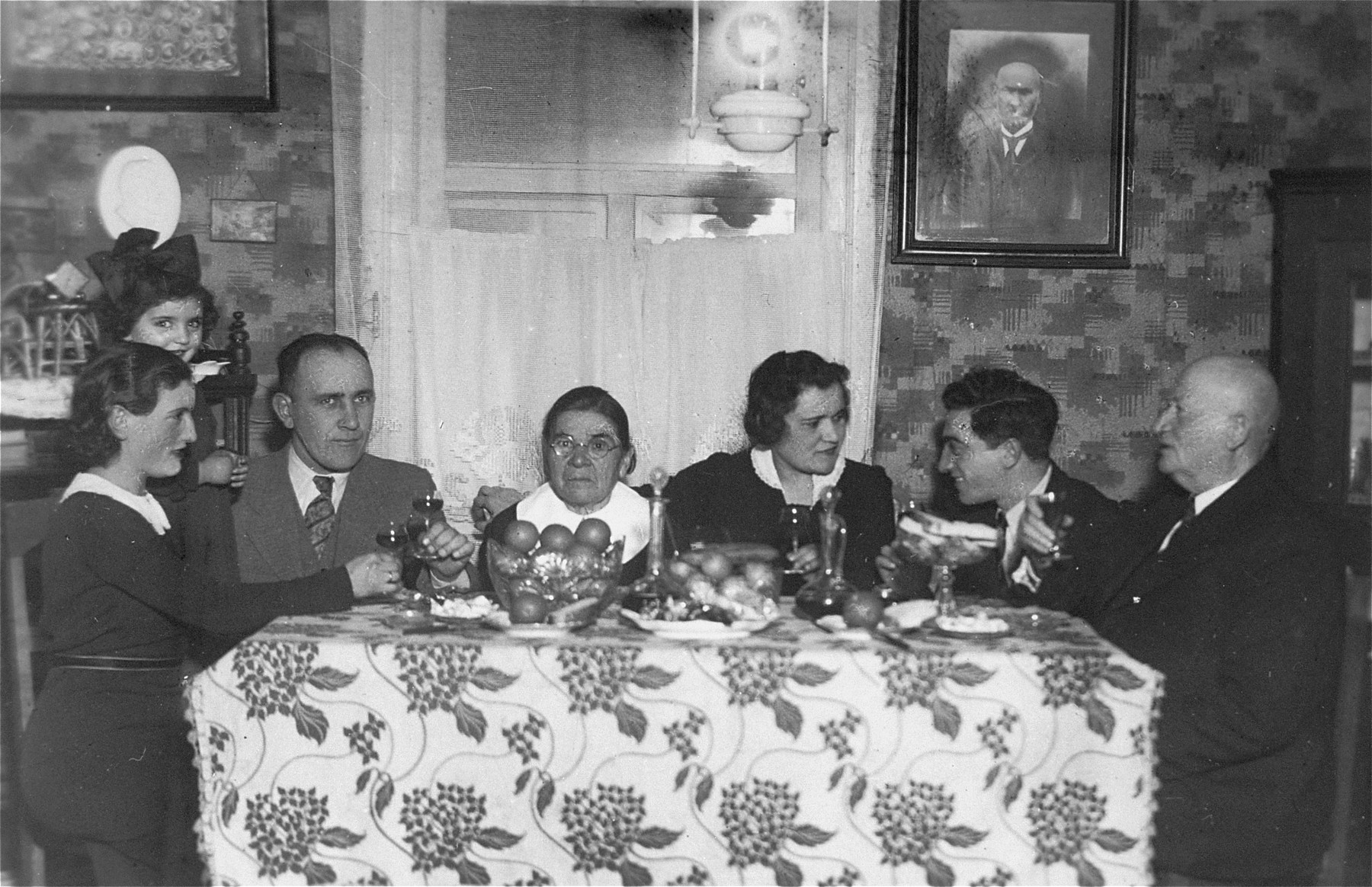 The engaged couple, Eliezer and Chaya Gar, eat at the Gar home in Kron.  Pictured from left to right are: Baila, Chaviva, Jacob, Esther, and Chaya Gar; Eliezer Kaplan, and David Tkatch, a cousin of the Gars.