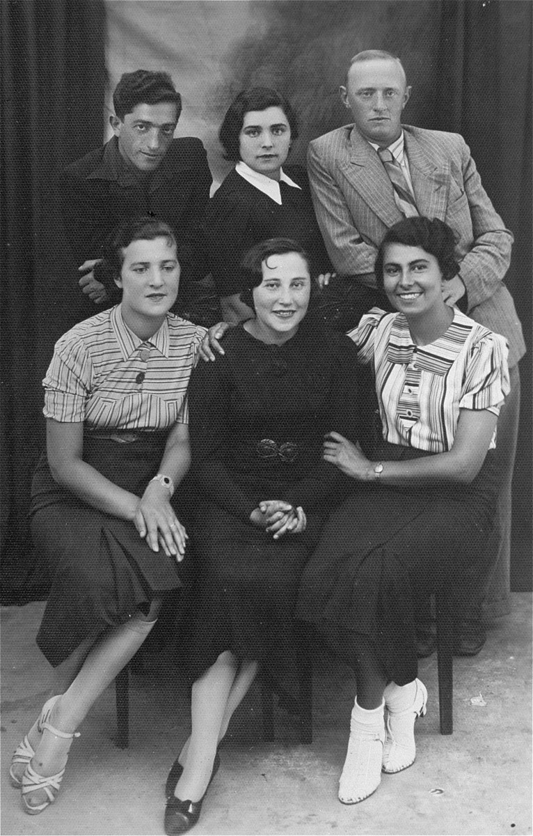 Group portrait of young Jewish men and women in Lithuania. Among those pictured are the donor's father, Eliezer Kaplan (top left), and her aunt, Nehama Kaplan (bottom right).