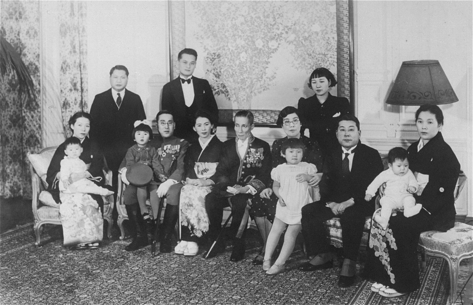 Chiune Sugihara poses with his family and friends at his residence in Kaunas.