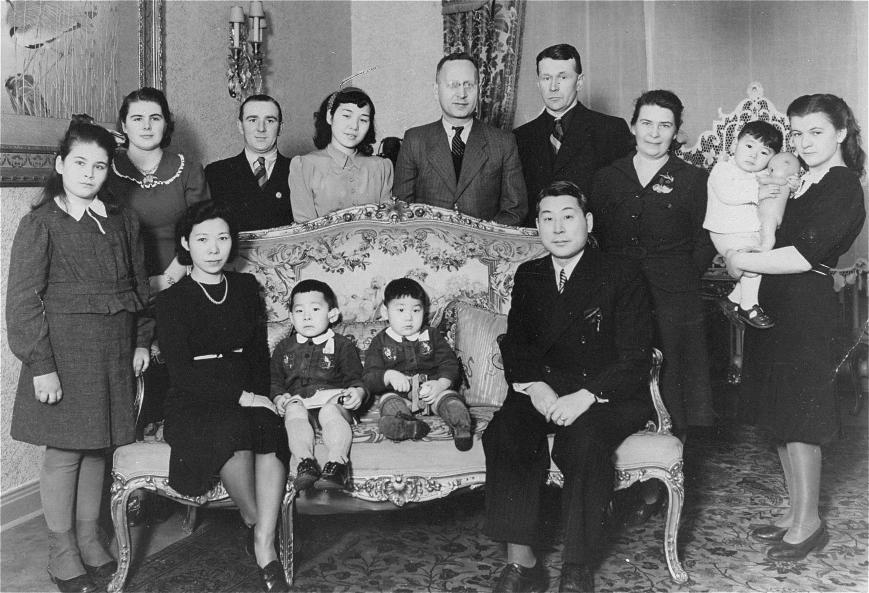 Chiune Sugihara poses with family and friends at his residence in Koenigsberg.