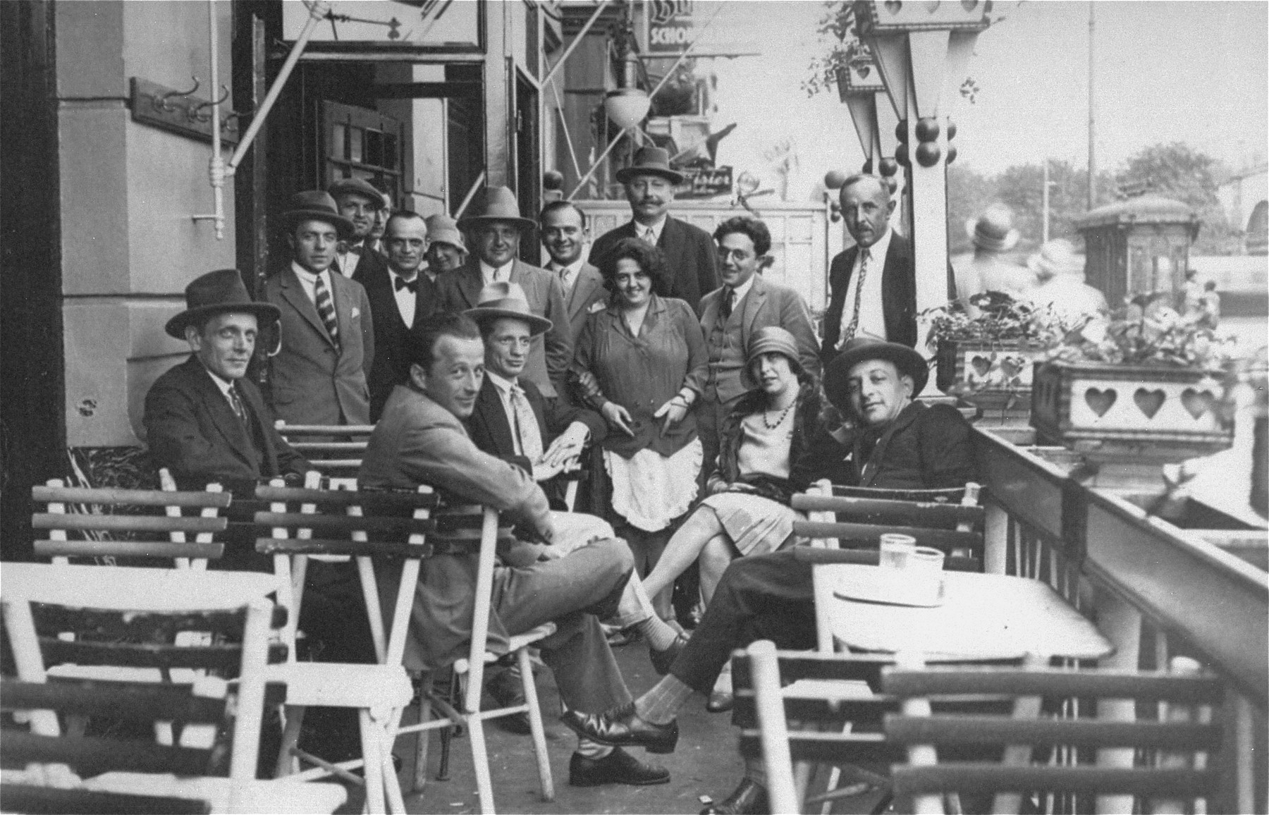 Austrian Jews at an outdoor cafe in Vienna.    Pictured are members of the Fiedler and Goldstaub families.