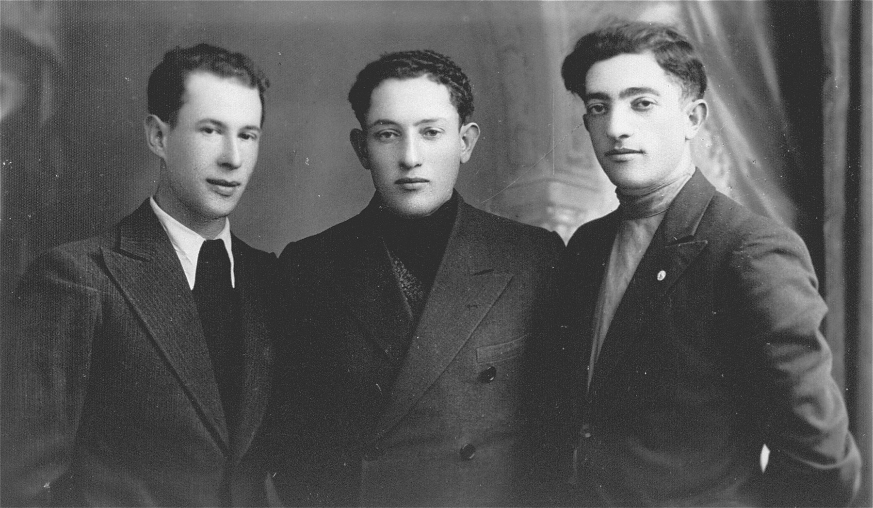 Close-up of three young, Jewish men in Lithuania . The donor's father, Eliezer Kaplan, is pictured on the right.