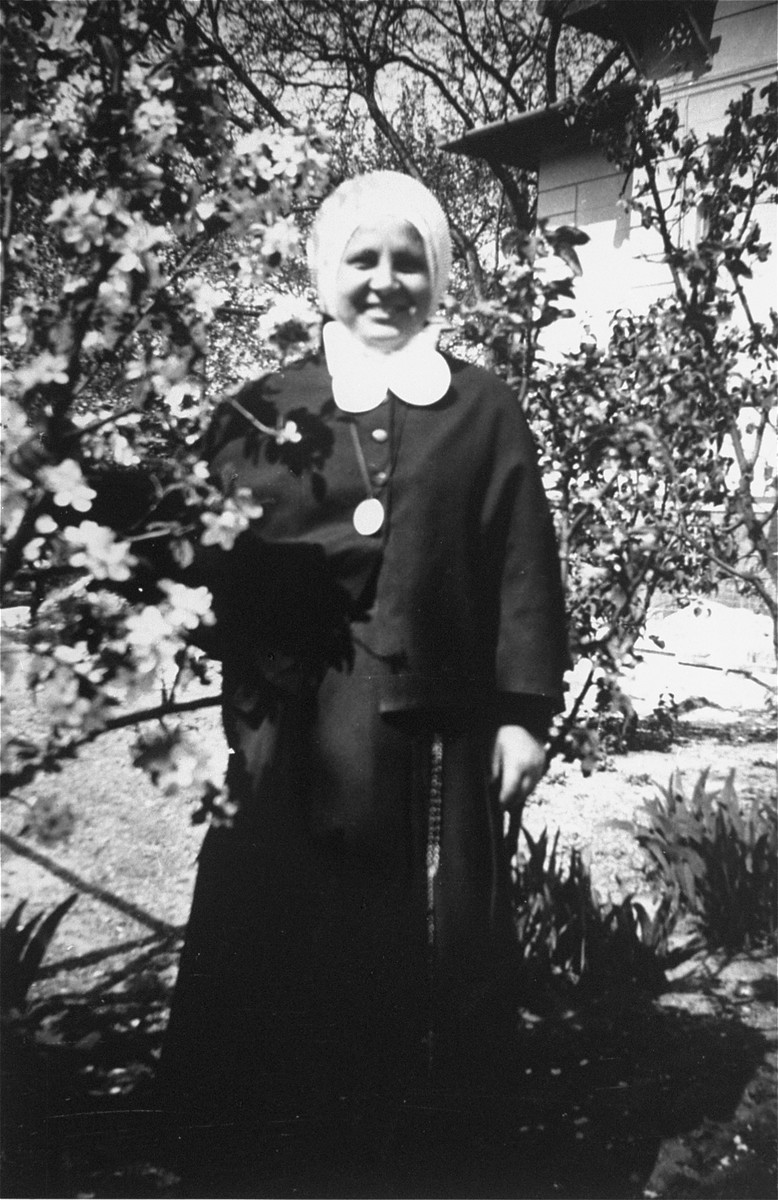 Portrait of a nun standing outside the convent school near Budapest where Dorottya Dezsoefi, and her twin sister, Ida Marianne, were hidden for two years.
