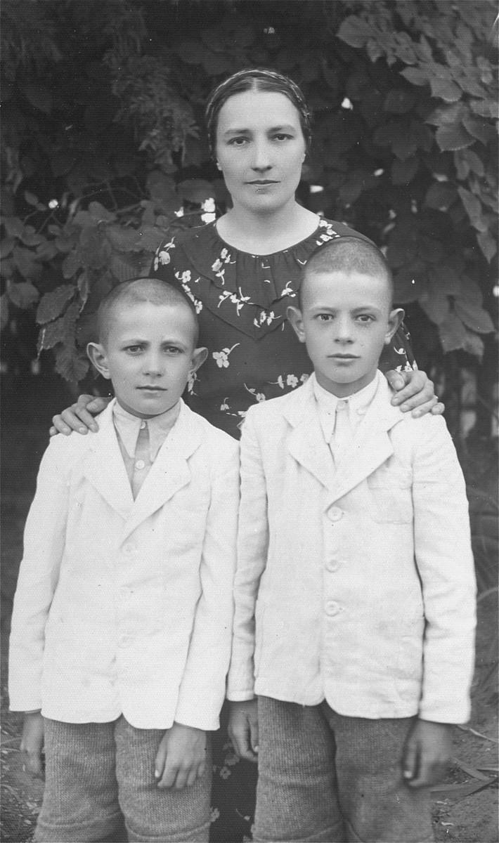 Polish rescuer Jadwiga Wanda Wlodek poses with her two sons, Krystyn and Janusz.