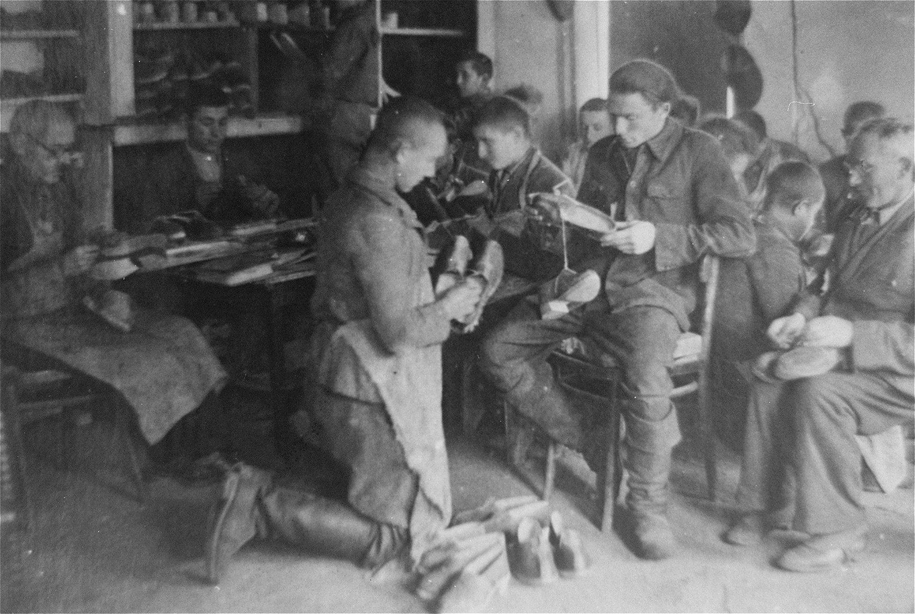 Jewish men at work producing wooden shoes in the Glubokoye ghetto.