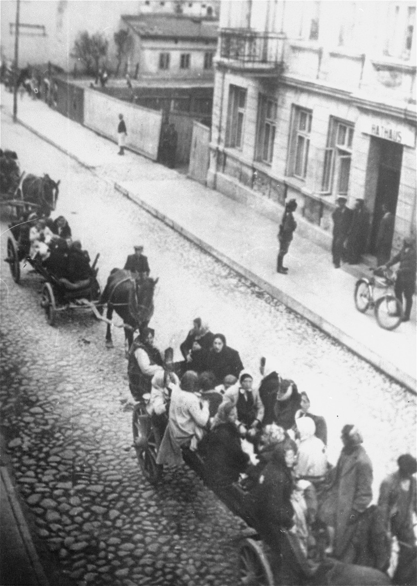 During a deportation action in the Brzeziny ghetto, Jews are taken by horse-drawn wagons to the railroad station in Galkowek.