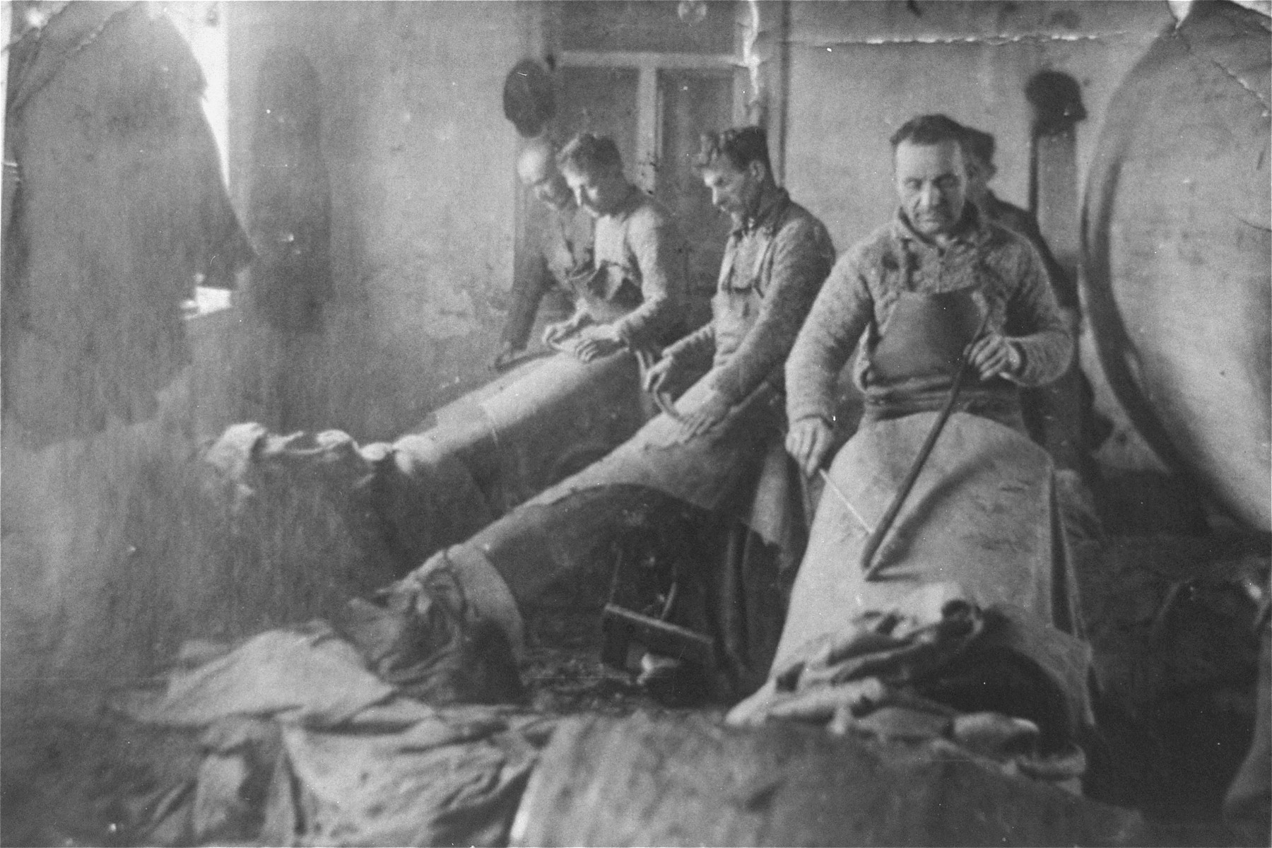 Jewish men working in a tanning workshop in the Glubokoye ghetto.