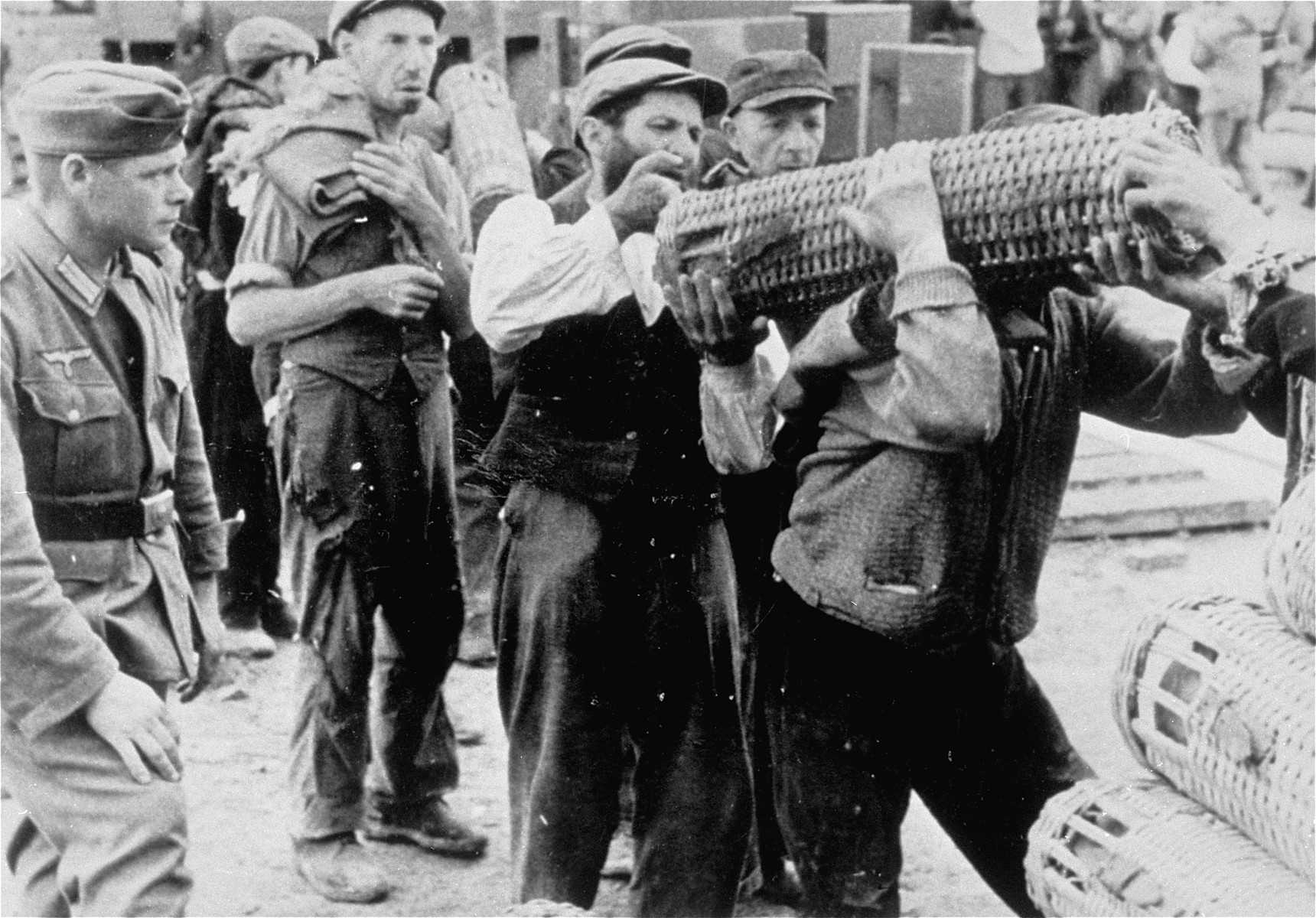 Jews at forced labor carrying artillery munitions.