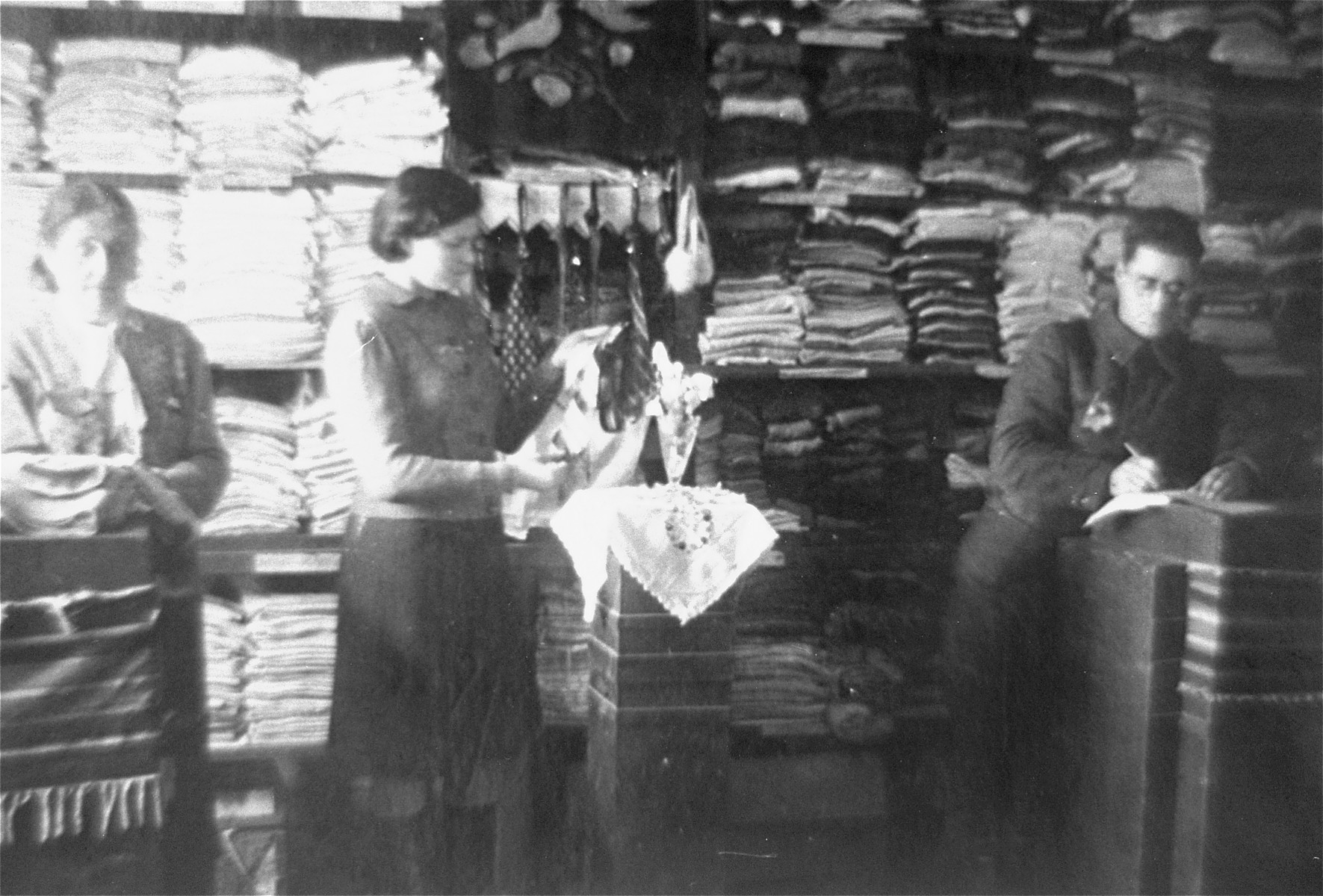 Jews working in a storeroom of a workshop in the Glubokoye ghetto.