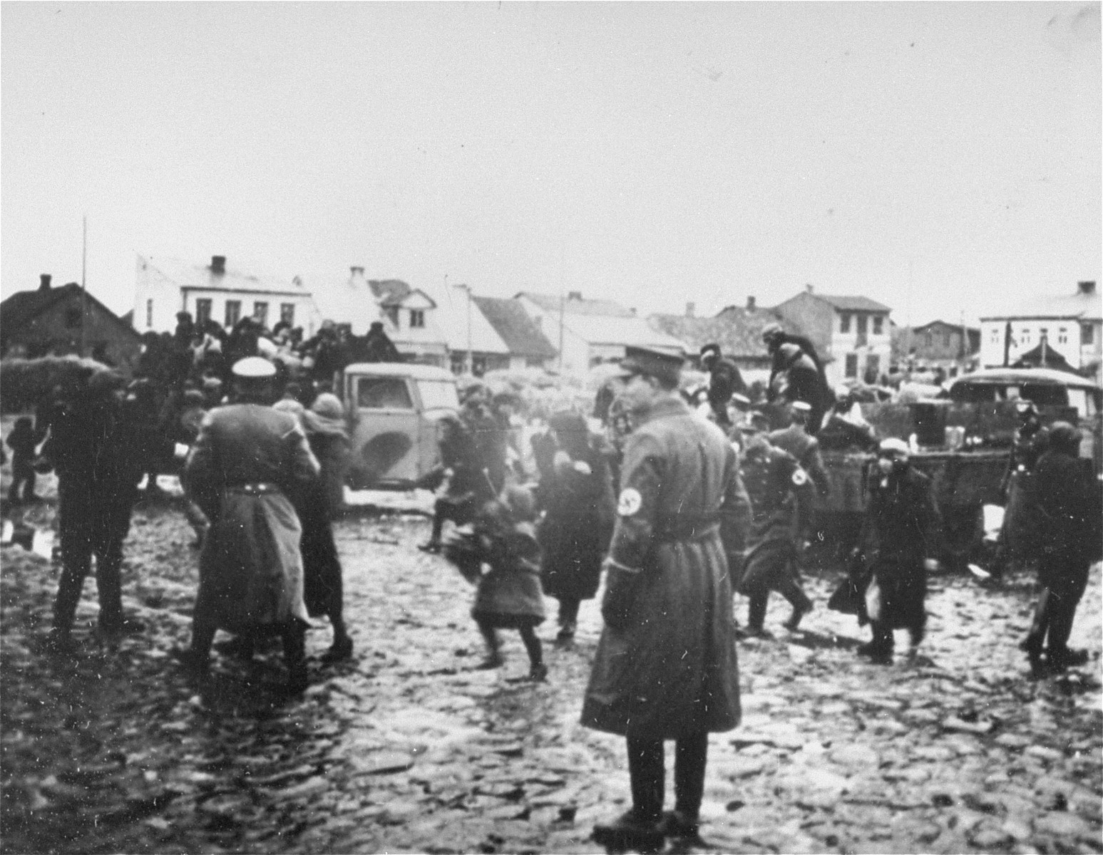 German police round-up Jews and load them onto trucks in the Ciechanow ghetto.