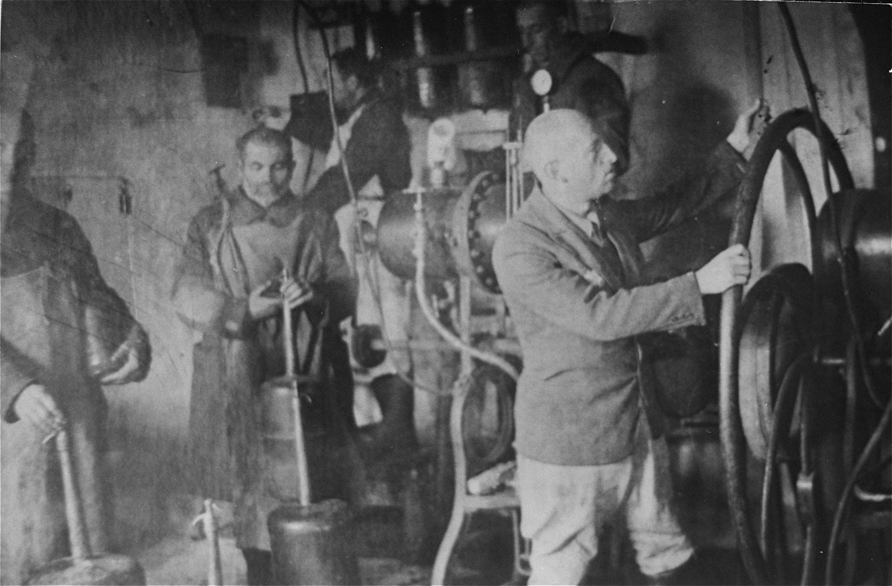 Jewish men at work in a tanning factory in the Glubokoye ghetto.