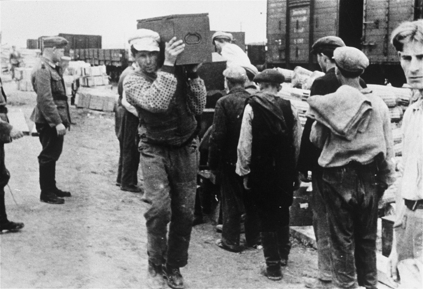 Jews at forced labor unloading artillery munitions at a Wehrmacht supply depot.