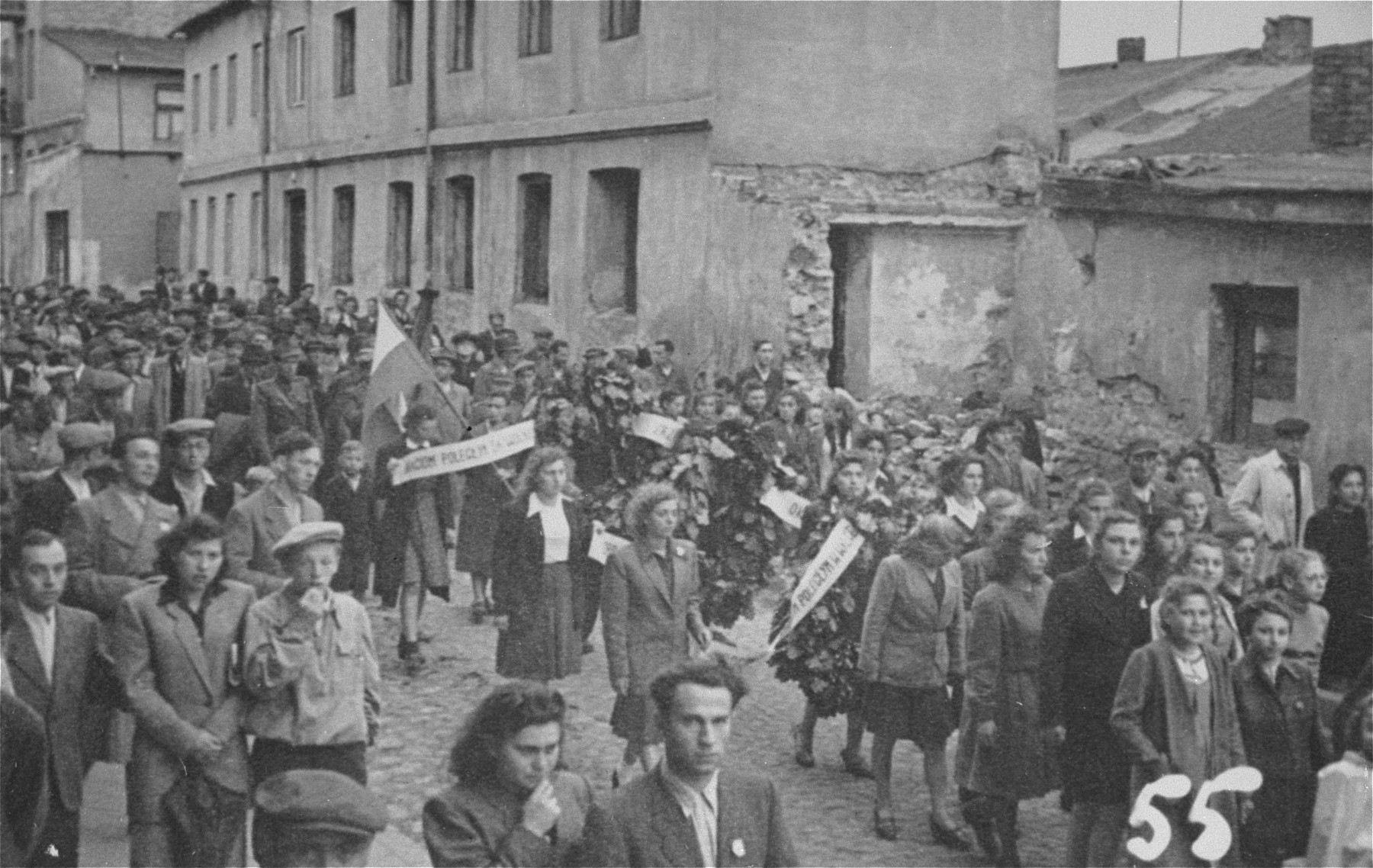 Jewish survivors in Czestochowa march along Spadkowa-Kozia Street in protest against the way Jewish victims of German actions in the small ghetto were buried in mass graves filled with lime.  Hela and Jack Shipper are pictured in the foreground in the center.  As a result of the protest, the bodies were exhumed and buried in the Jewish cemetery in Czestochowa.  Among the victims were the donor's brother, Leib Shipper, his sister, Yentel (Shipper) Owieczko, and her daughter, Hela.