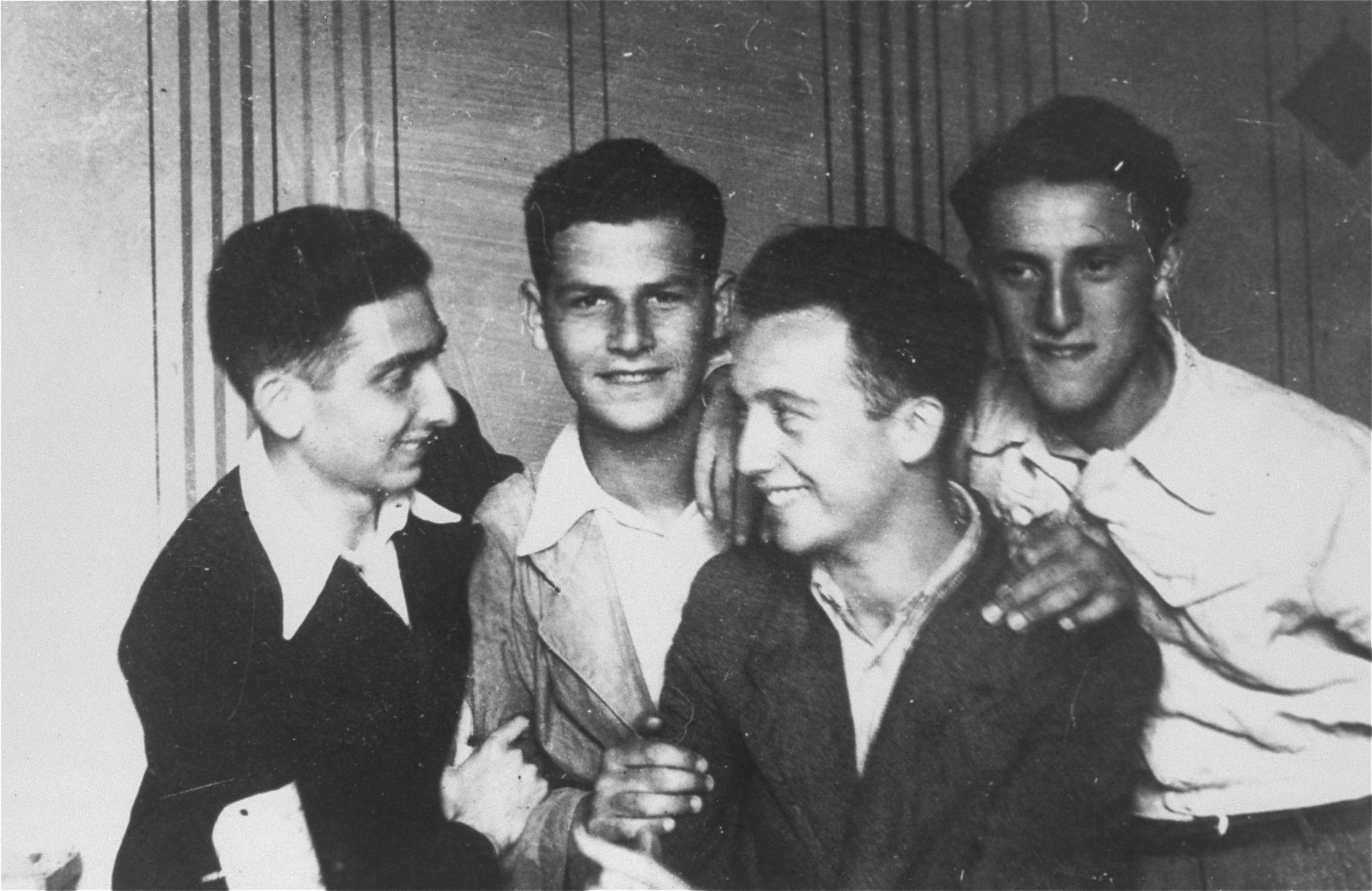 Four young male friends in the Borislaw ghetto.  Pictured from left to right are: Rolek Harmelin, Ducek Egit, Jurek Haberman (the donor's brother) and Imek Eisenstein.   Jurek  was shot by the Germans in the Borislaw labor camp on July 19, 1944, just three weeks before the arrival of the Red Army.   Rolek Harmelin survived the war and emigrated to Australia.