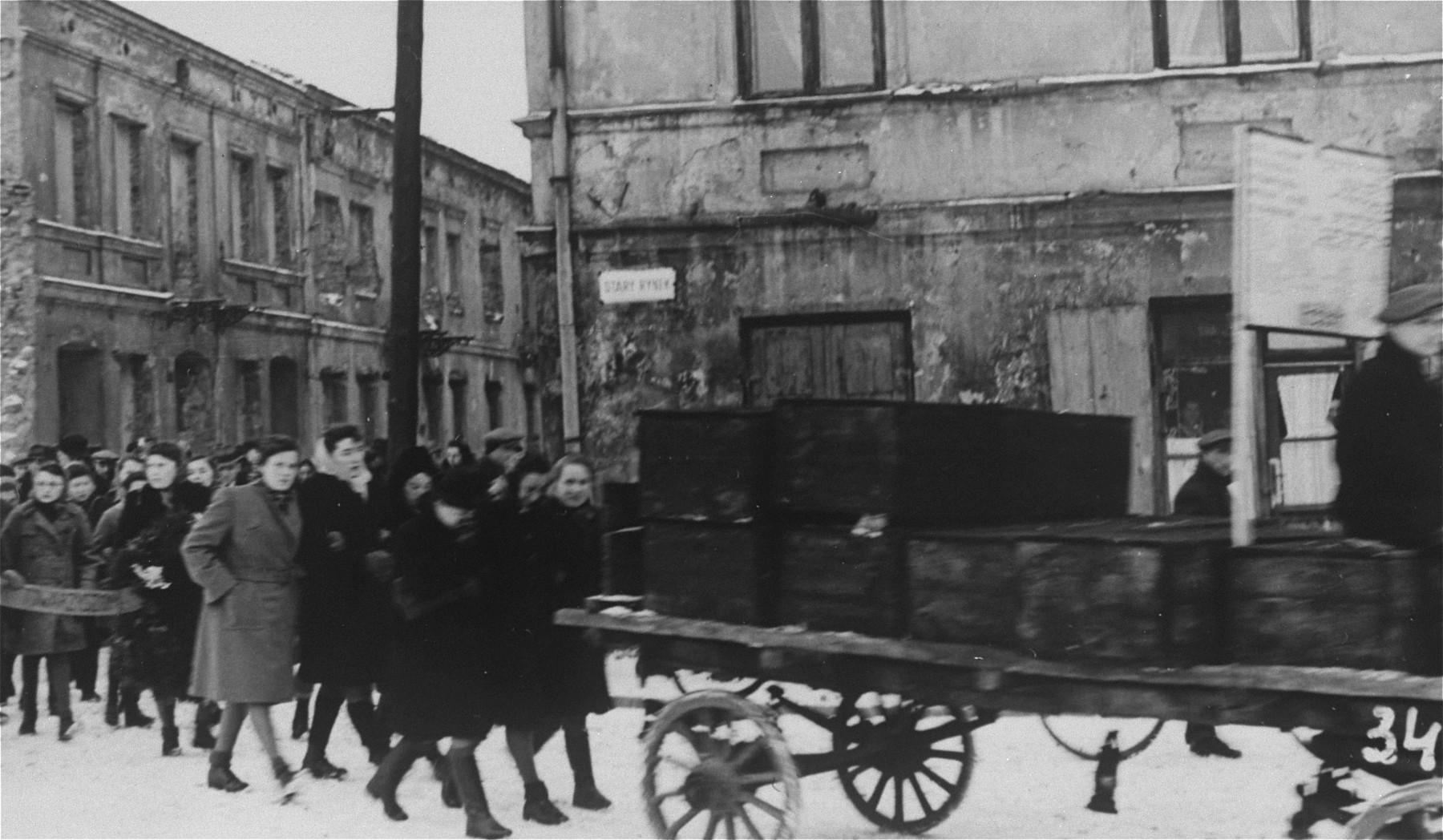 Jewish survivors walk behind a wagon of coffins during a funeral procession  through the snow covered streets of Czestochowa. - Collections Search -  United States Holocaust Memorial Museum