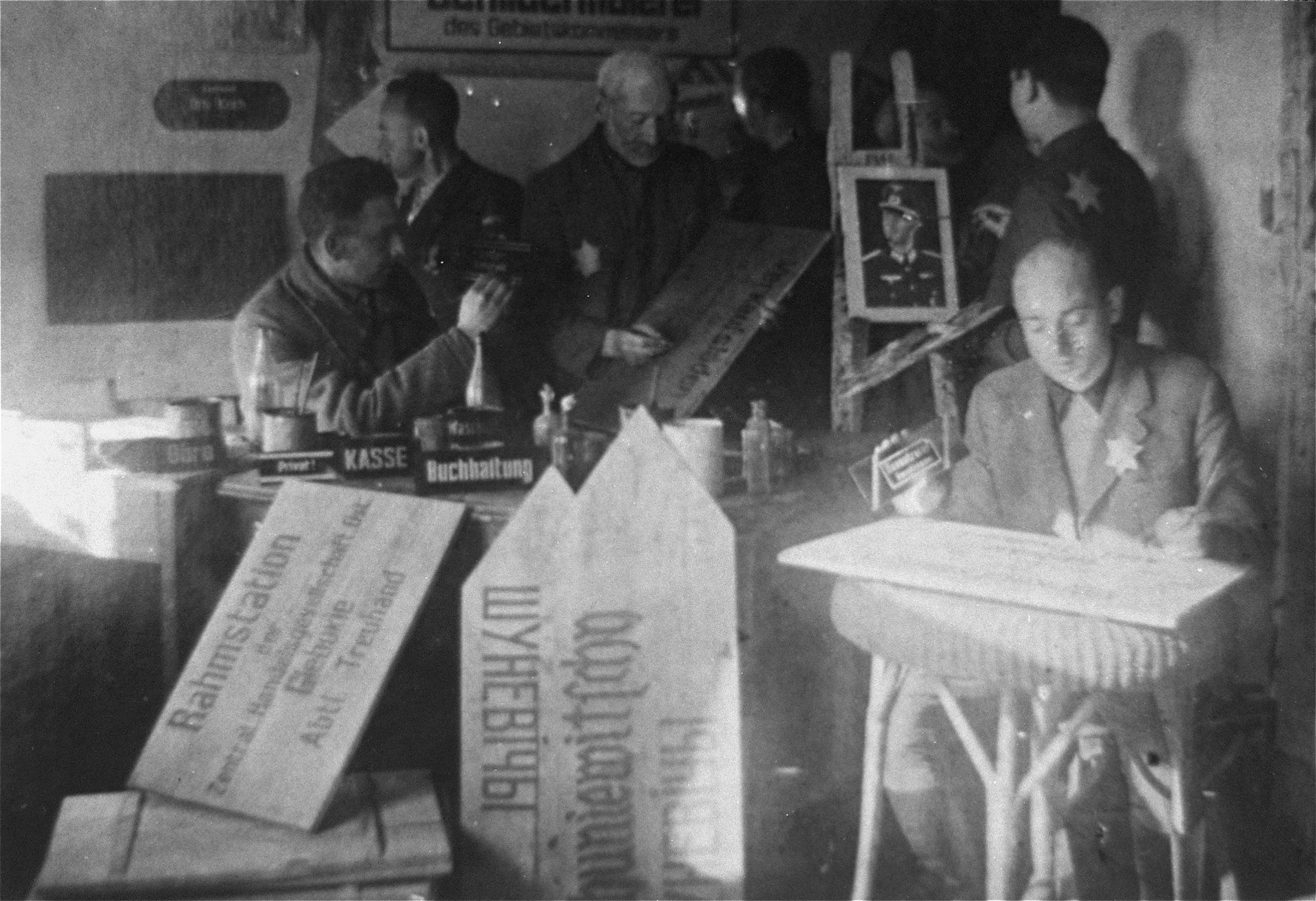 Jewish men making signs in a workshop in the Glubokoye ghetto.