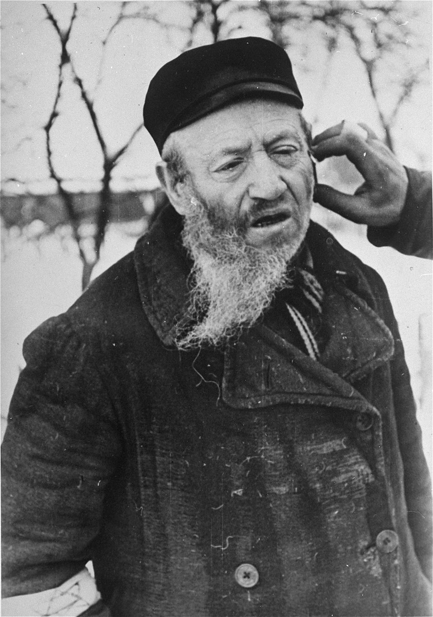A religious Jew in Hrubieszow endures the humiliation of having his beard cut off.