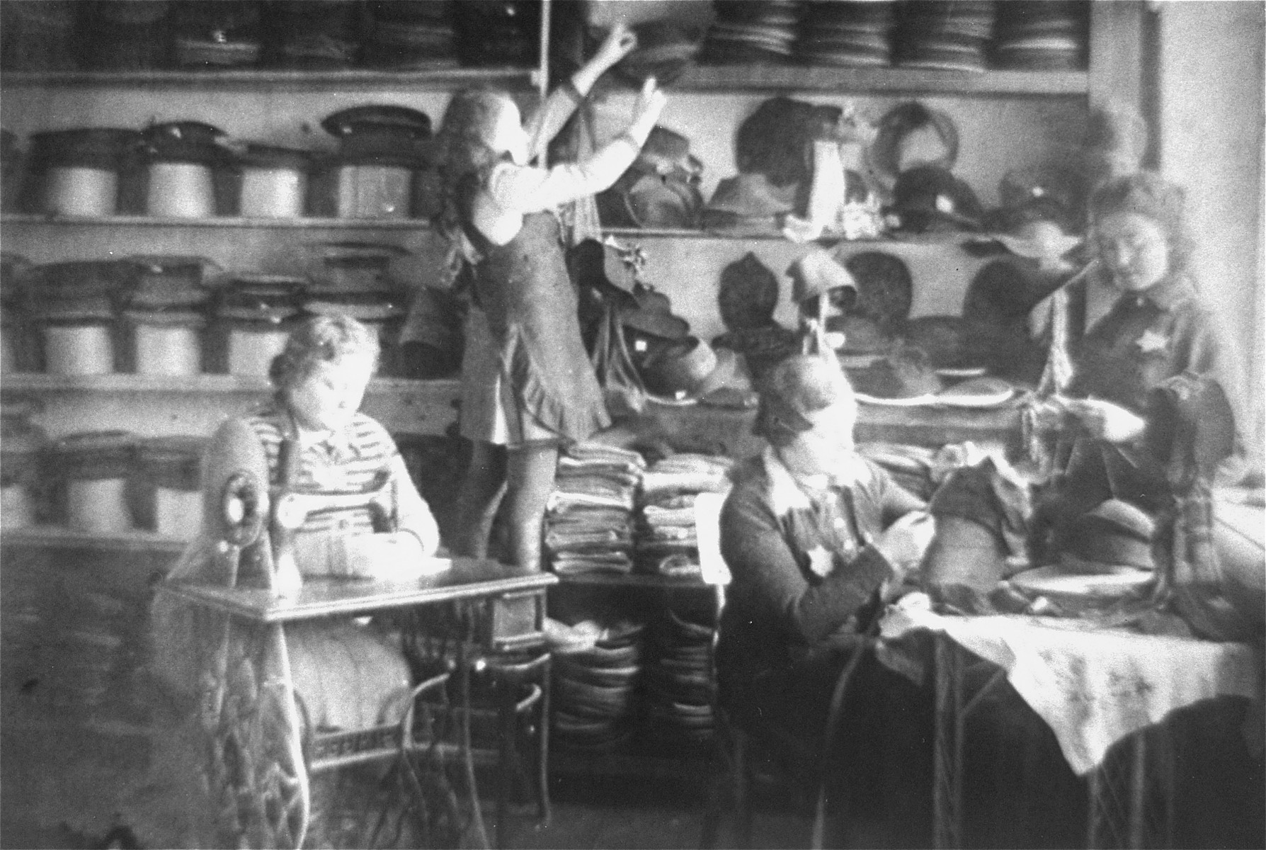 Jewish women working in a hatmaking workshop in the Glubokoye ghetto.    Among those pictured are Rivale and Rajze Lederman.