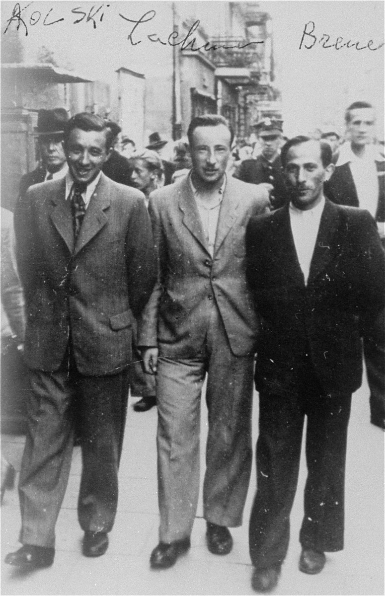Three survivors of the Treblinka uprising walk along a street in Warsaw after the war.  Pictured from left to right are Abraham Kolski, Shaya Lachman, and Henoch Brener.  After participating in the Treblinka uprising, they escaped from the camp with six other prisoners, and found temporary refuge in the nearby forest.  After several days in the forest, they encoutered a local farmer, Stanislaw Pogorzelski, who agreed to take them in.  Stanislaw and his elderly father Julian hid the group of nine for nearly a year, until liberation, and provided food and medical care .  On July 8, 1969, Yad Vashem recognized Julian Pogorzelski and his son Stanislaw Pogorzelski as Righteous Among the Nations.