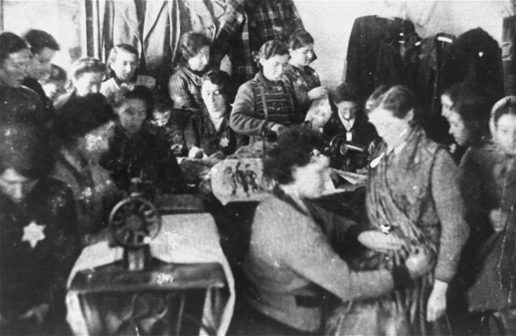 Jewish women working in a sewing workshop in the Glubokoye ghetto.    Among those pictured is Chana Tzarlevitz.
