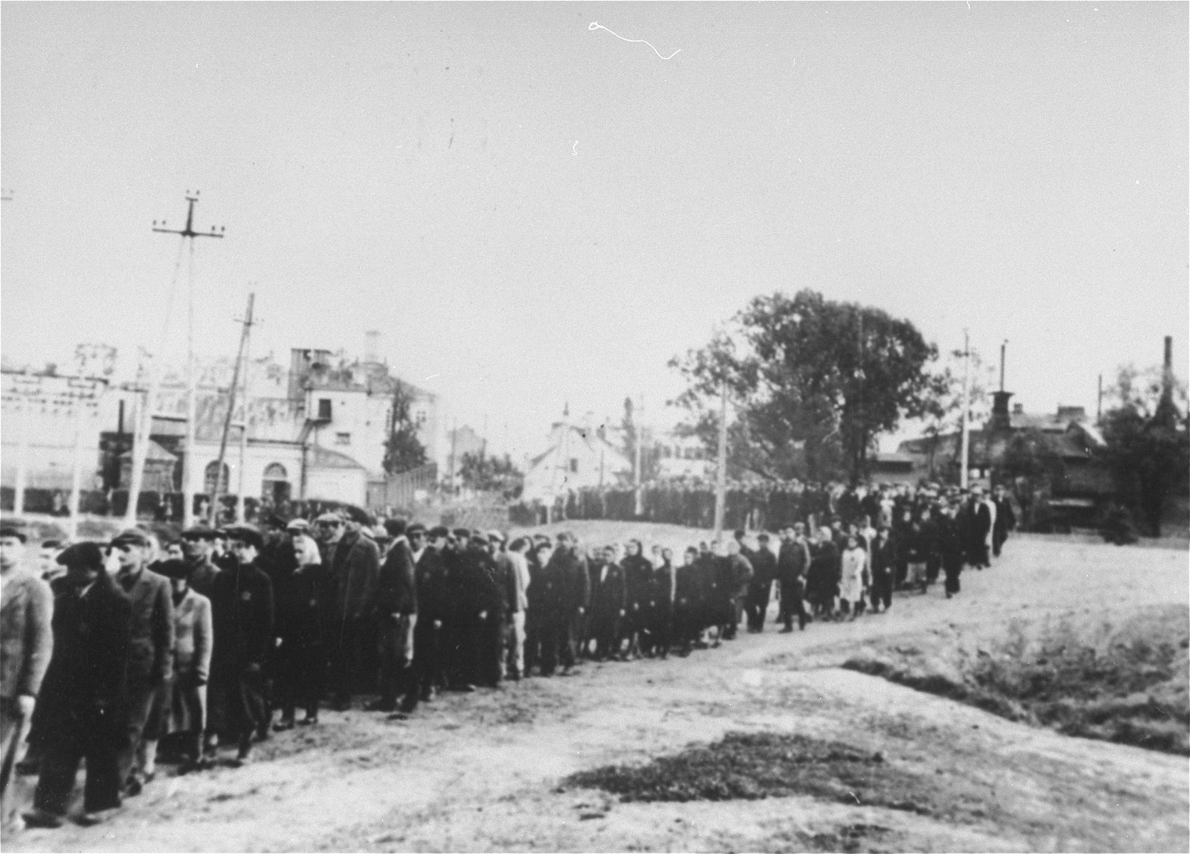 Jews from the Ciechanow ghetto are marched out of town to a fortress.