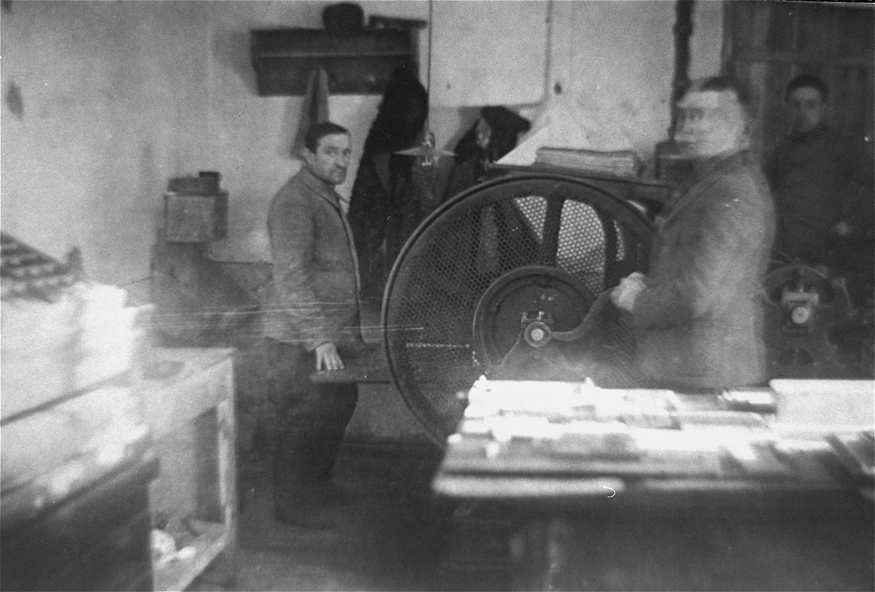Jewish men working at a printing press in the Glubokoye ghetto.