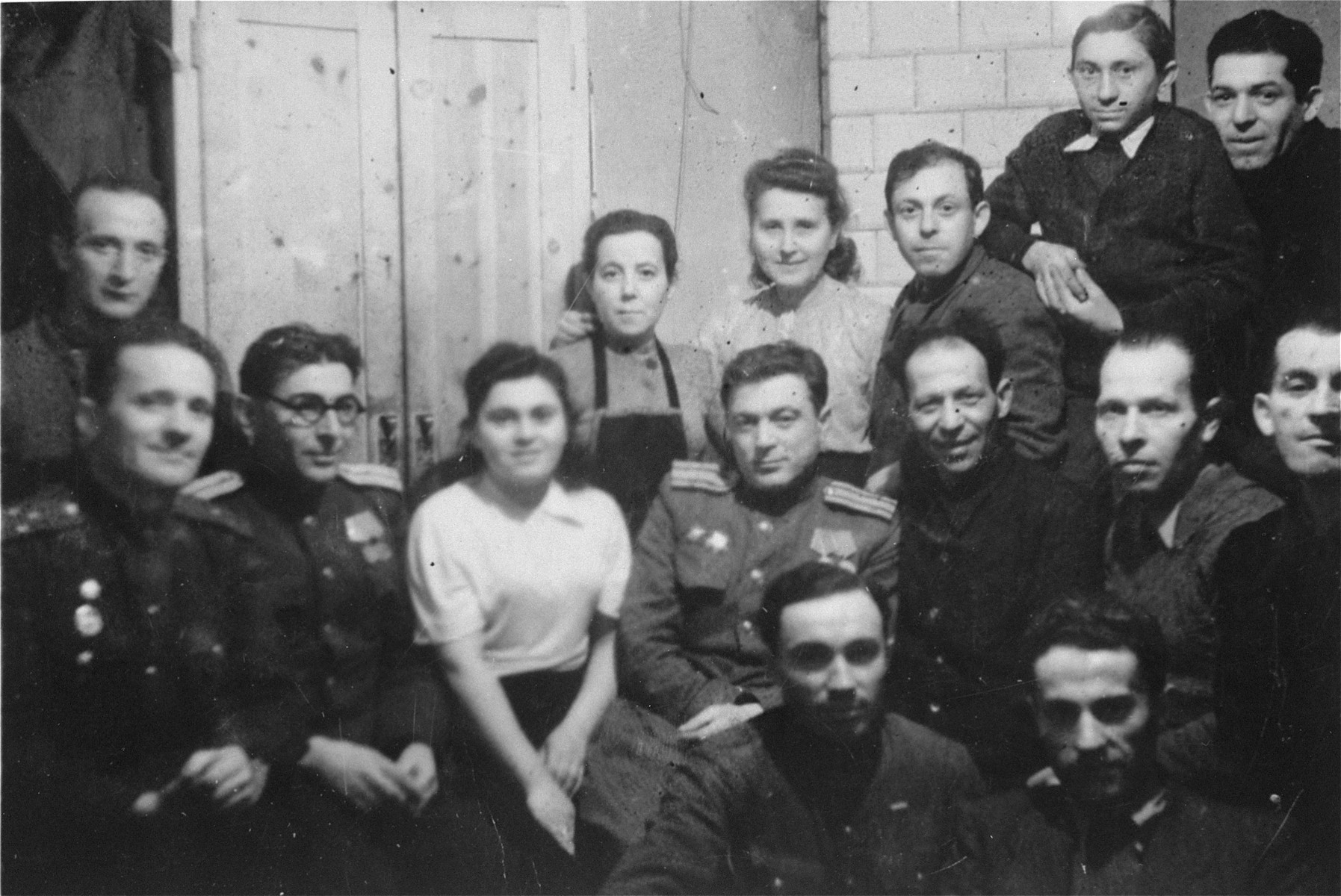 Jewish survivors in Czestochowa pose with Soviet soldiers and officers who liberated the area.  Among those pictured are Jack and Hela Shipper, Laibish Kornberg and Hershel Proszeh.