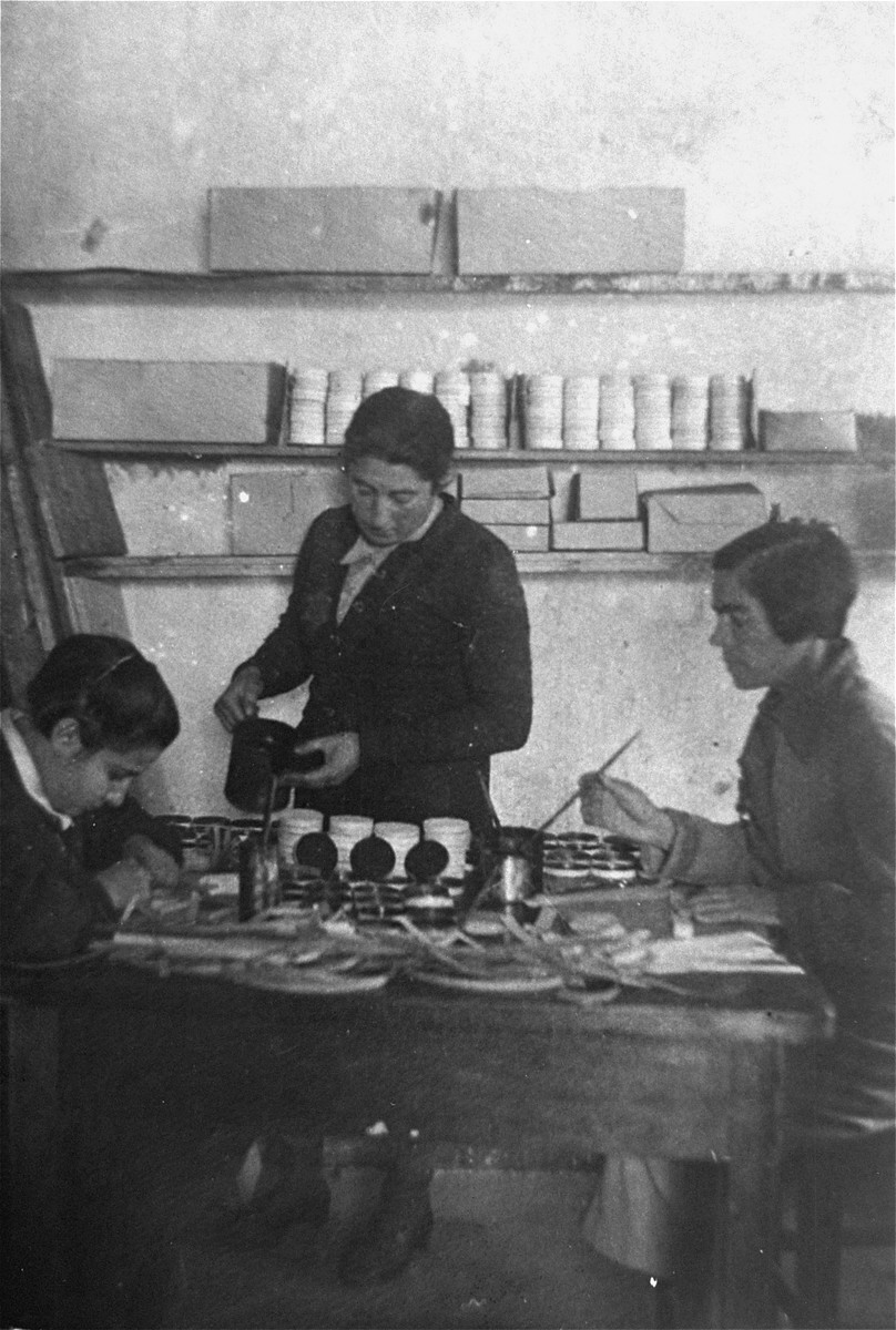 Jewish women make shoe polish at a workshop in the Glubokoye ghetto.