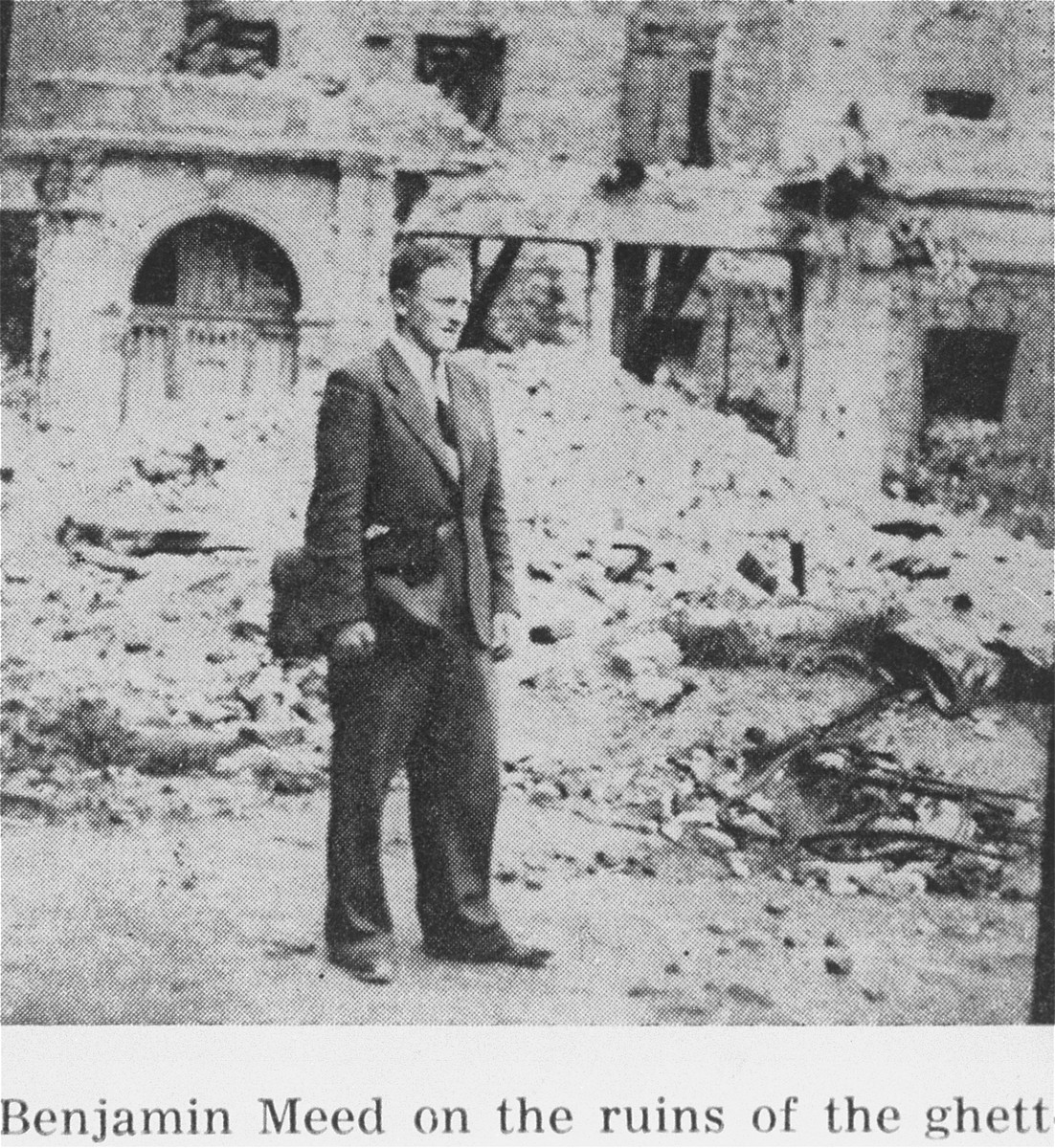 While living in hiding on the Aryan side of Warsaw, Benjamin Miedzyrzecki returns to the site of the Warsaw ghetto, where he poses among the ruins.