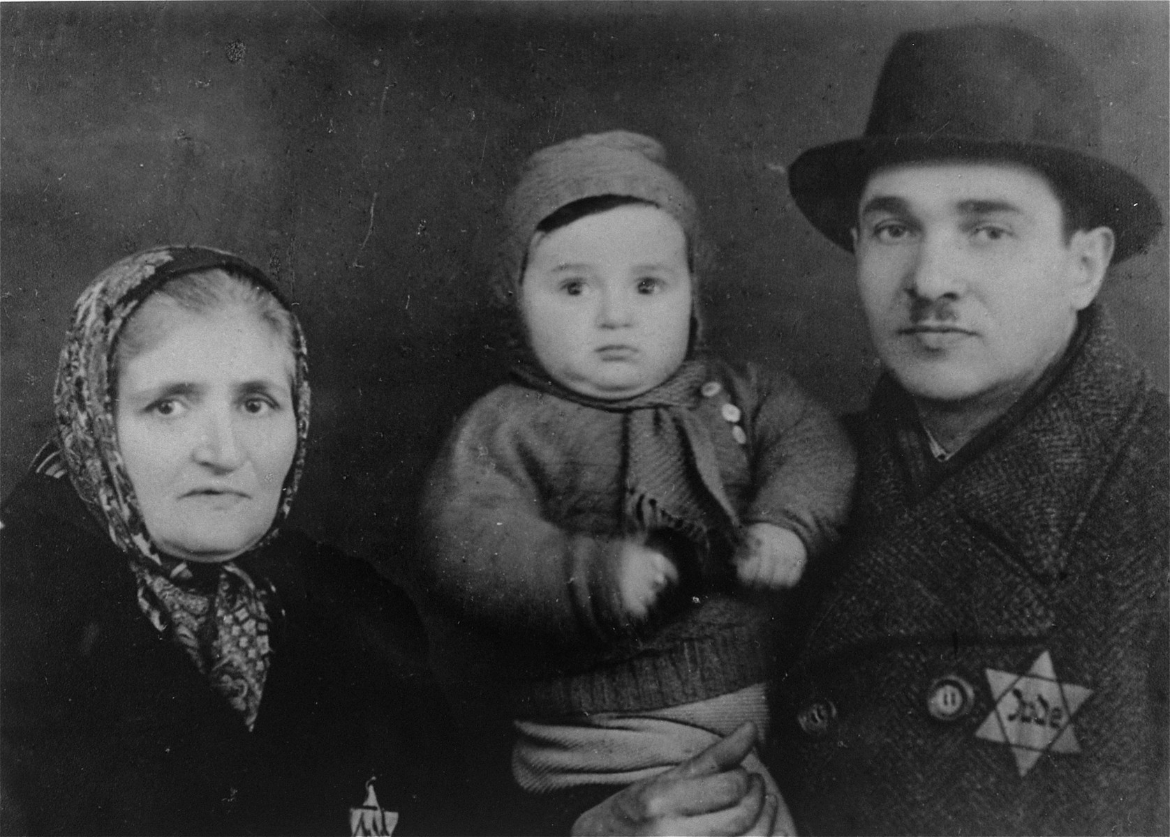 Studio portrait of a Jewish family in the Czeladz ghetto.  Pictured are three members of the Urman family.  All were murdered in Auschwitz in 1943.