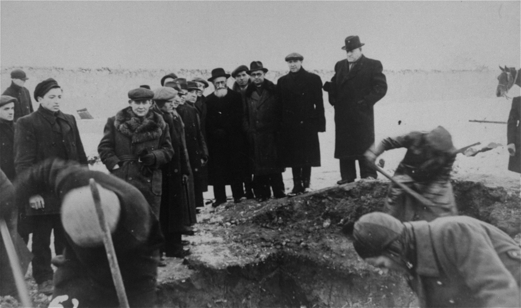 Jewish survivors exhume a mass grave containing the remains of Jews murdered by the Germans in Czestochowa during World War II.