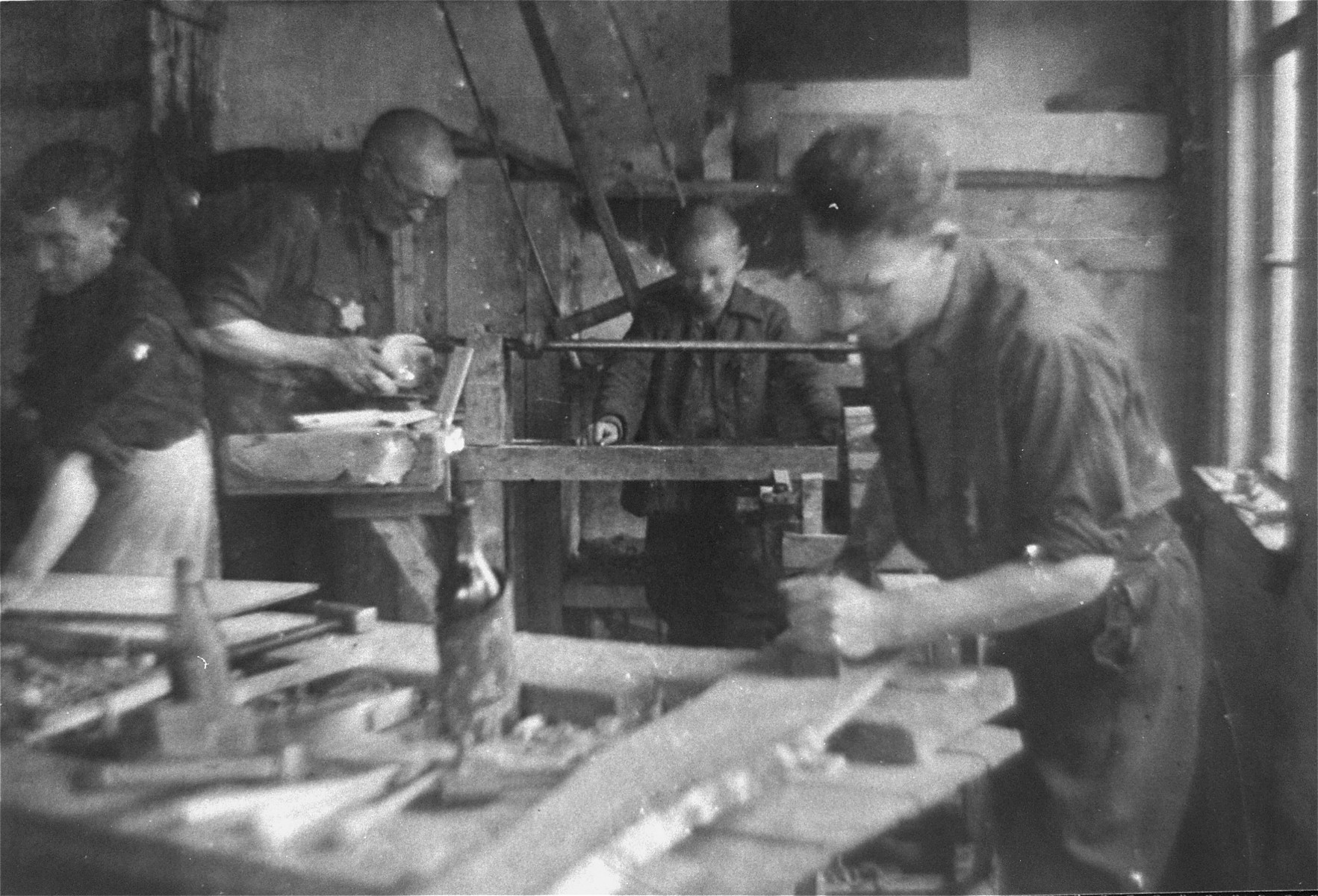 Jewish men working in a carpentry workshop in the Glubokoye ghetto.    Among those pictured is Israel Alperowicz.