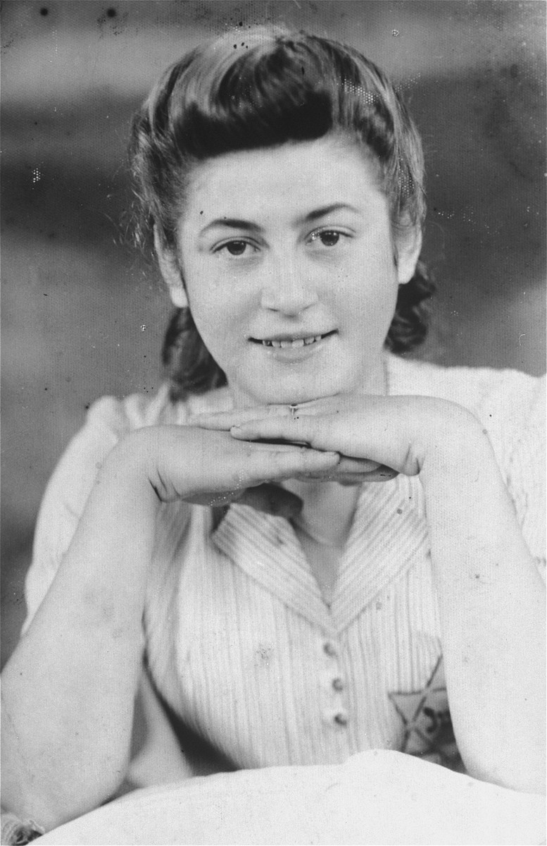 "Portrait of a young Jewish woman in the Czeladz ghetto.  Pictured is Lola Cukierman Magier.  The Polish caption on the back reads: ""15.V.1942 during the war, unknown what tomorrow might bring."""