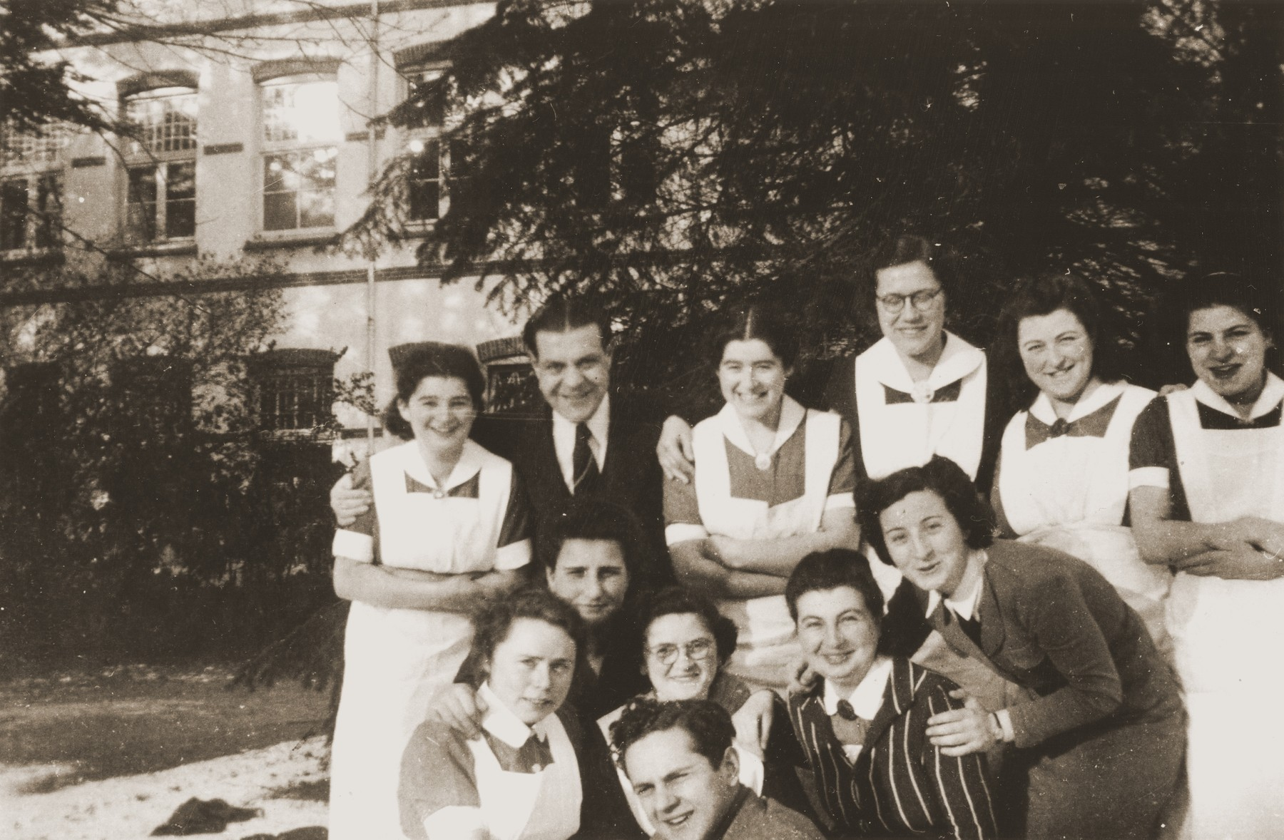 Group portrait of doctors and nurses at the Jewish psychiatric hospital in Apeldoorn [Het Apeldoornse Bos].  Among those pictured is Renee (Sara) Meijer.