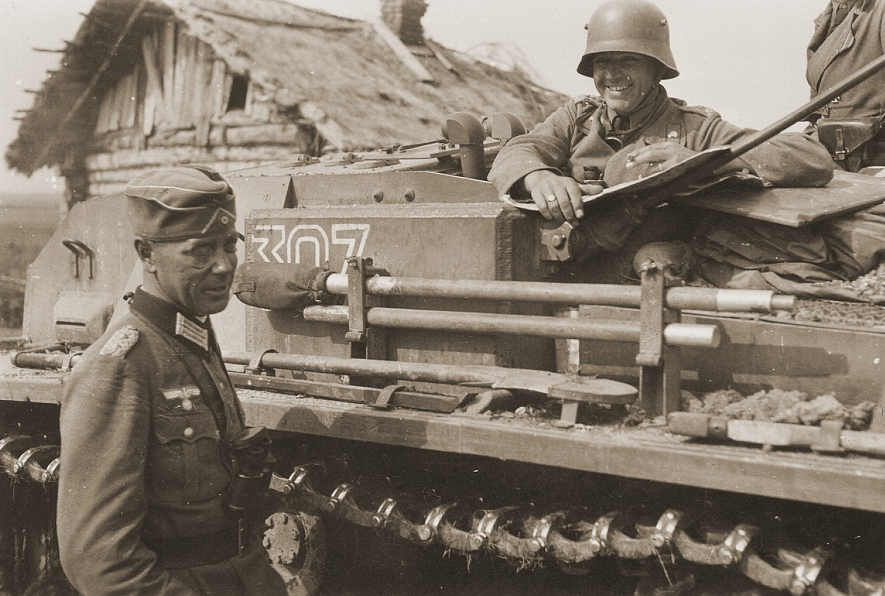 A German Colonel with a Waffen-SS tank crew on the Eastern Front.