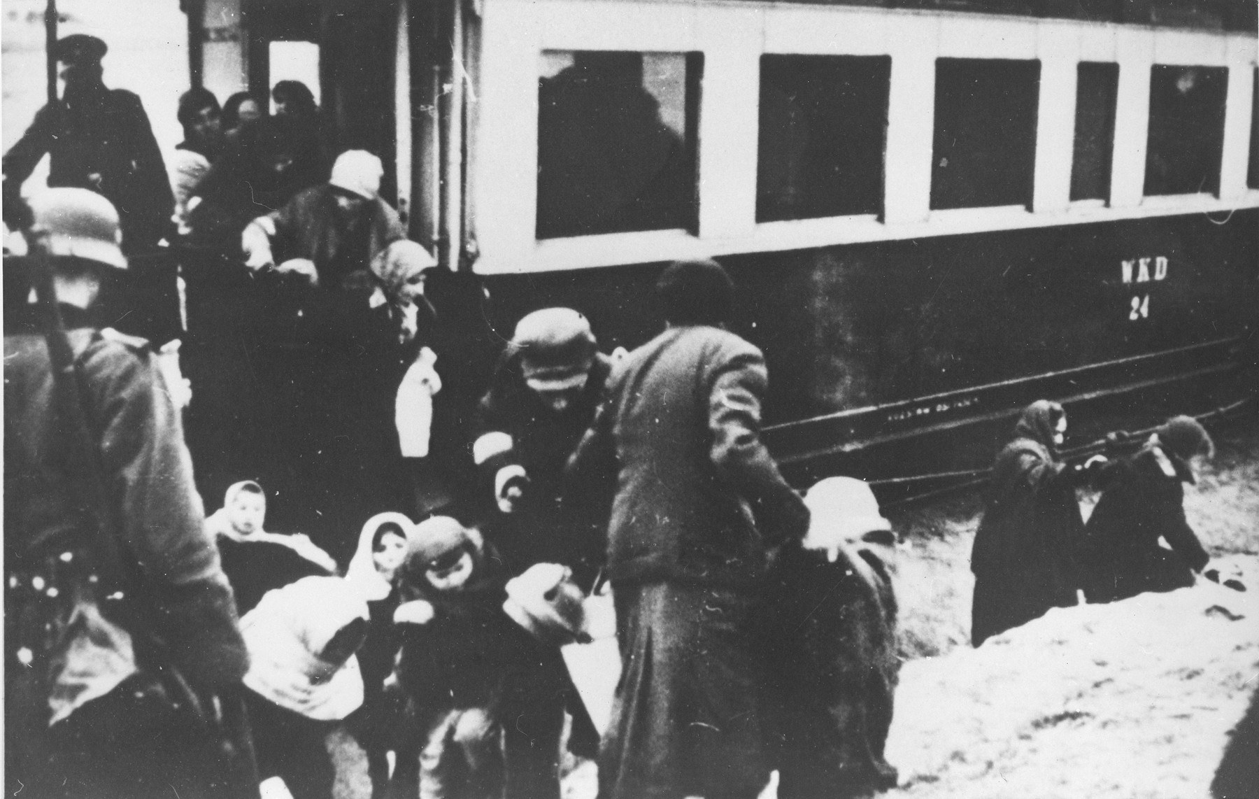 Polish Jews arrive by passenger train to the Warsaw ghetto.