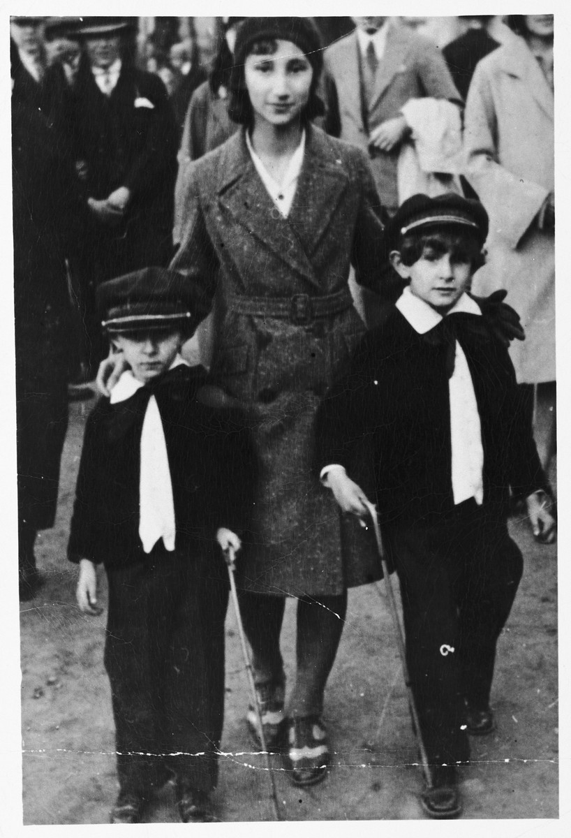 Three Jewish siblings pose on a street in Krakow.  Pictured are Mela Rosner (the wife of donor Stanley Zanger) with her brothers Velvel (left) and Samek (right).