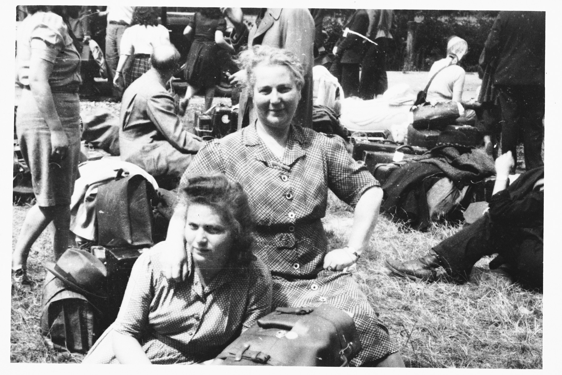Jewish DPs wait at an assembly point with their luggage to board the Marine Perch to sail to America.   Pictured are Erika Mannheimer (b. 1923 Bad Wildungen, Germany) and her mother, Lina Mannheimer nee Lilienstein (b. 1892 Gossfelden, Marburg, Germany). Both survived Riga, Kaiserwald, and Stutthof.  Shmuel Shalkovsky, the donor of the image, was appointed by the JDC as an escort for the passage.
