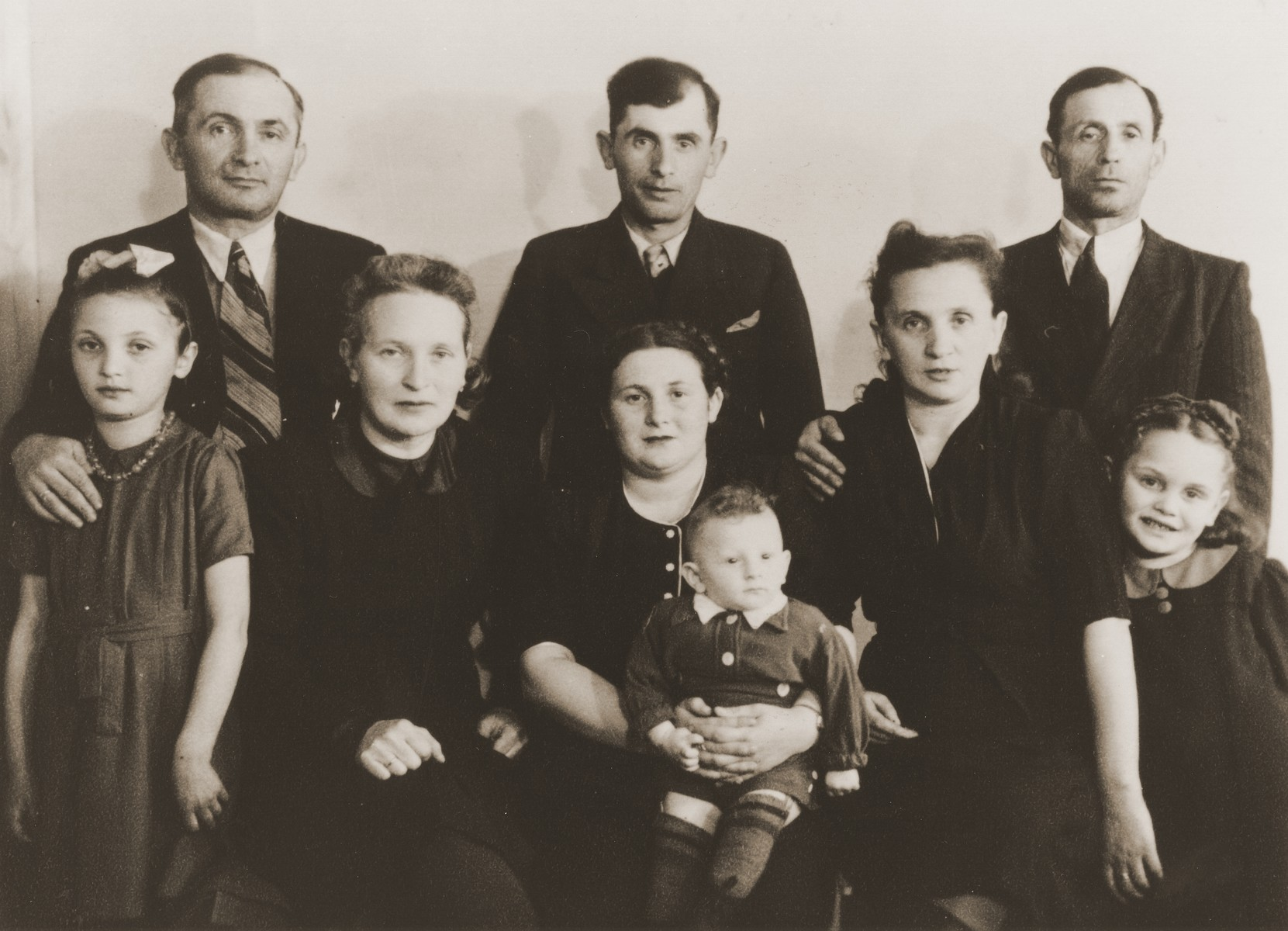 Group portrait of members of the Liekach family in Germany after the war.  Pictured are Moishe and Eta Leikach; Genia and Henry Leikach; Hinda Leikach; Mendel Leikach; Chaim and Rivka Lindenblatt; and Shulamis Leikach.