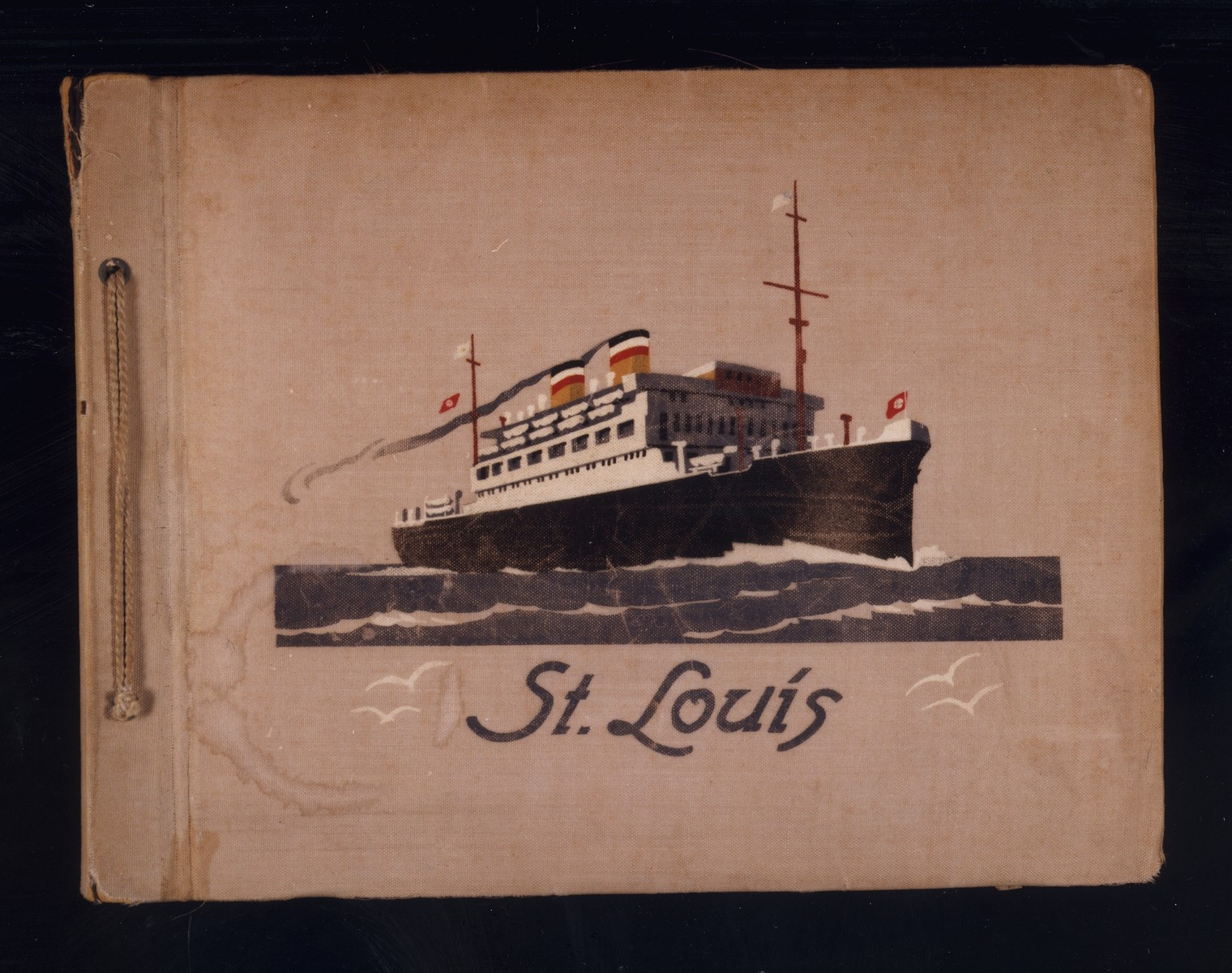 Cover of a photo album belonging to MS St. Louis passenger Fritz Buff featuring an image of the ship.