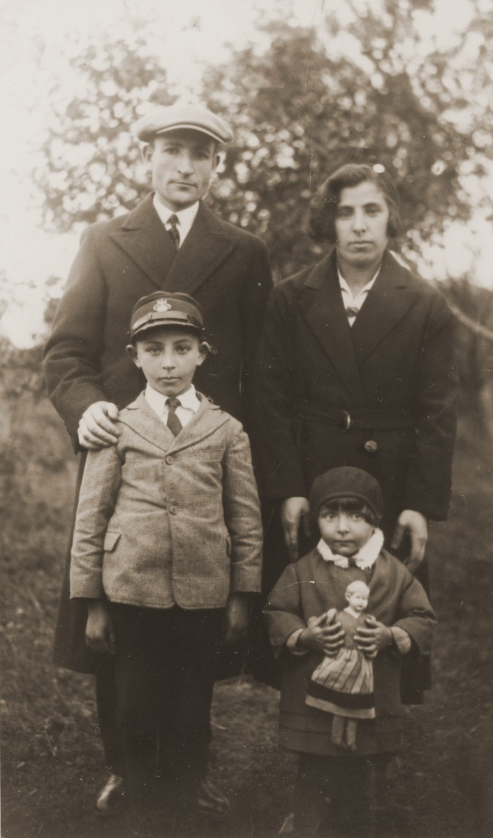 A Jewish couple poses with their two young children in Biala Rawska..