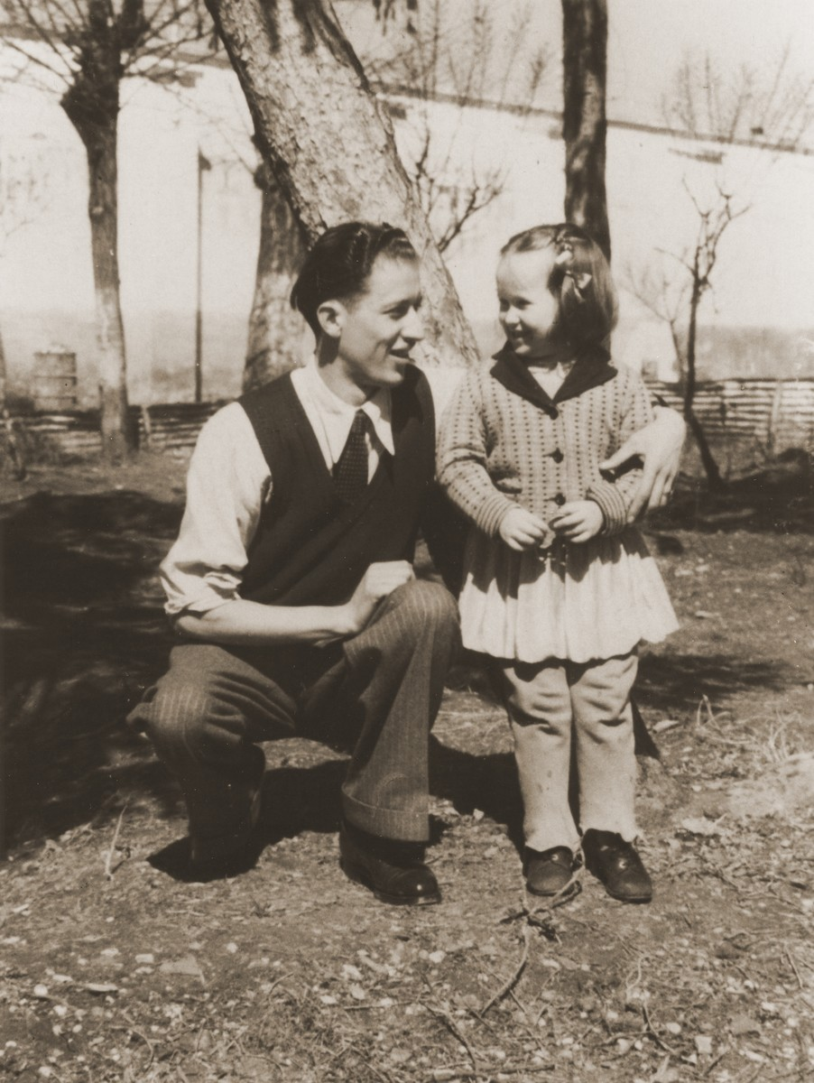 A Jewish DP child poses outside with a young man in the Cremona displaced persons camp.  Pictured is Masha Leikach.
