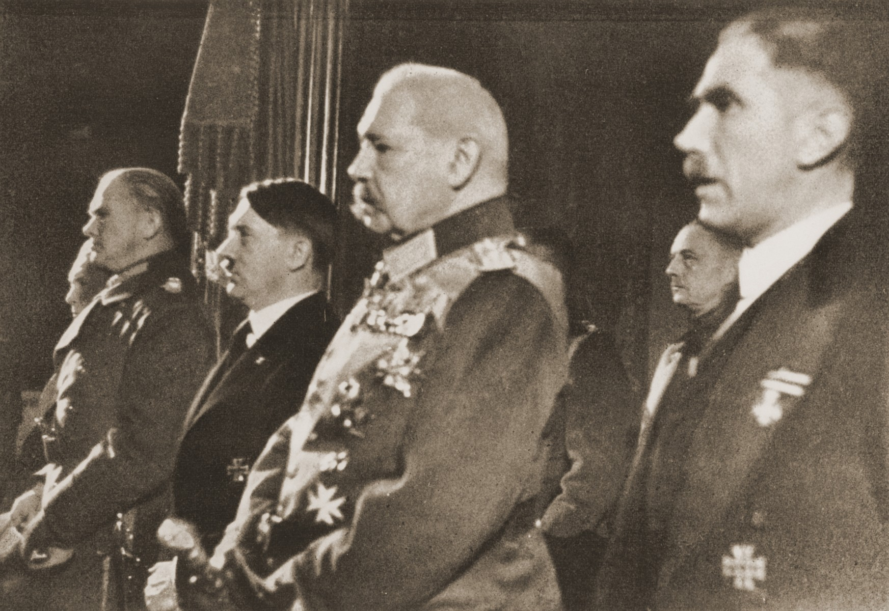 Members of the German leadership attend a ceremony honoring German soldiers killed in World War I at the National Opera in Berlin.  Pictured from right to left are: Franz von Papen, Paul von Hindenburg, Adolf Hitler and Werner von Blomberg.
